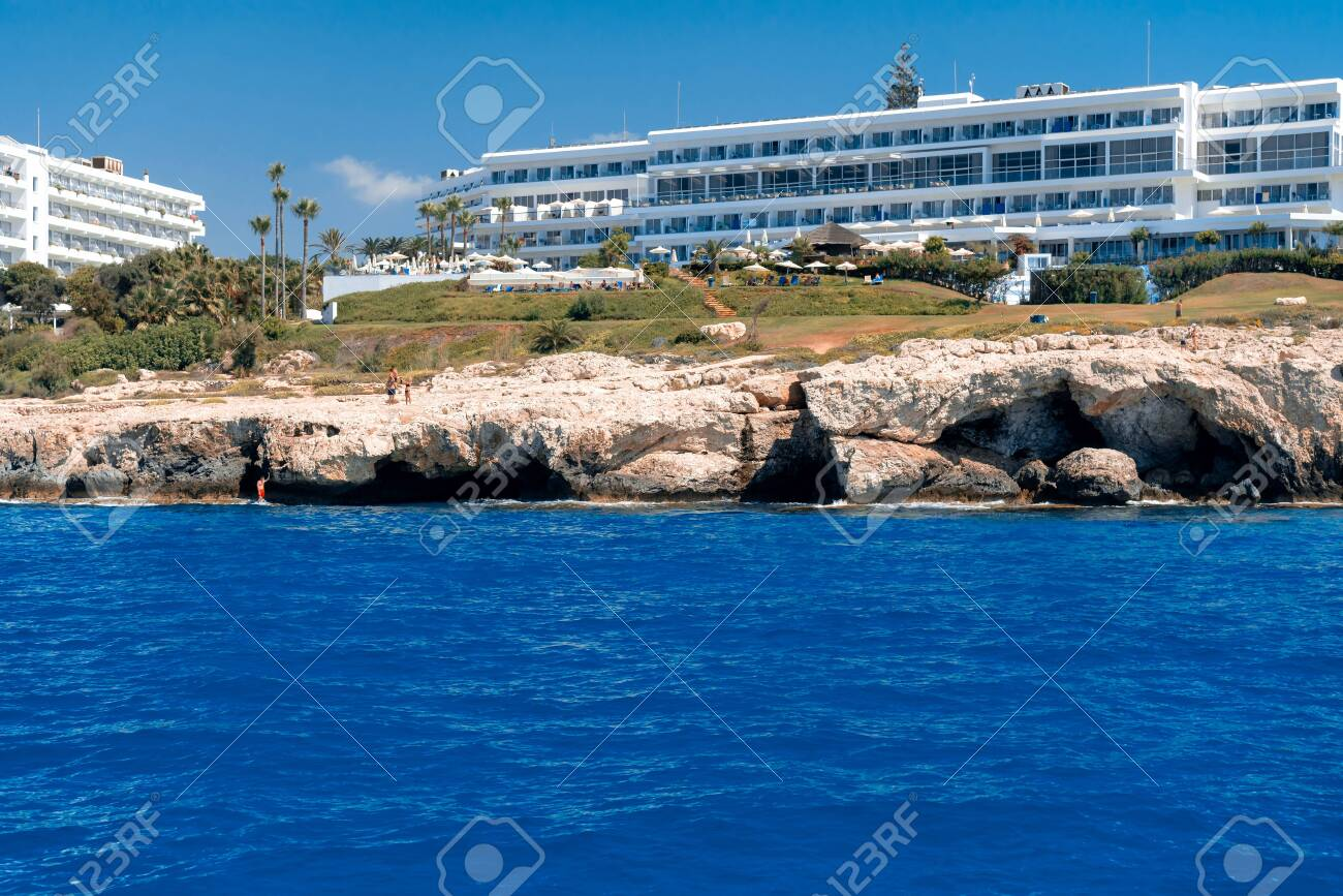 View of stone cliffs and hotels at Ayia Napa coastline . Famagusta district, Cyprus - 150716537