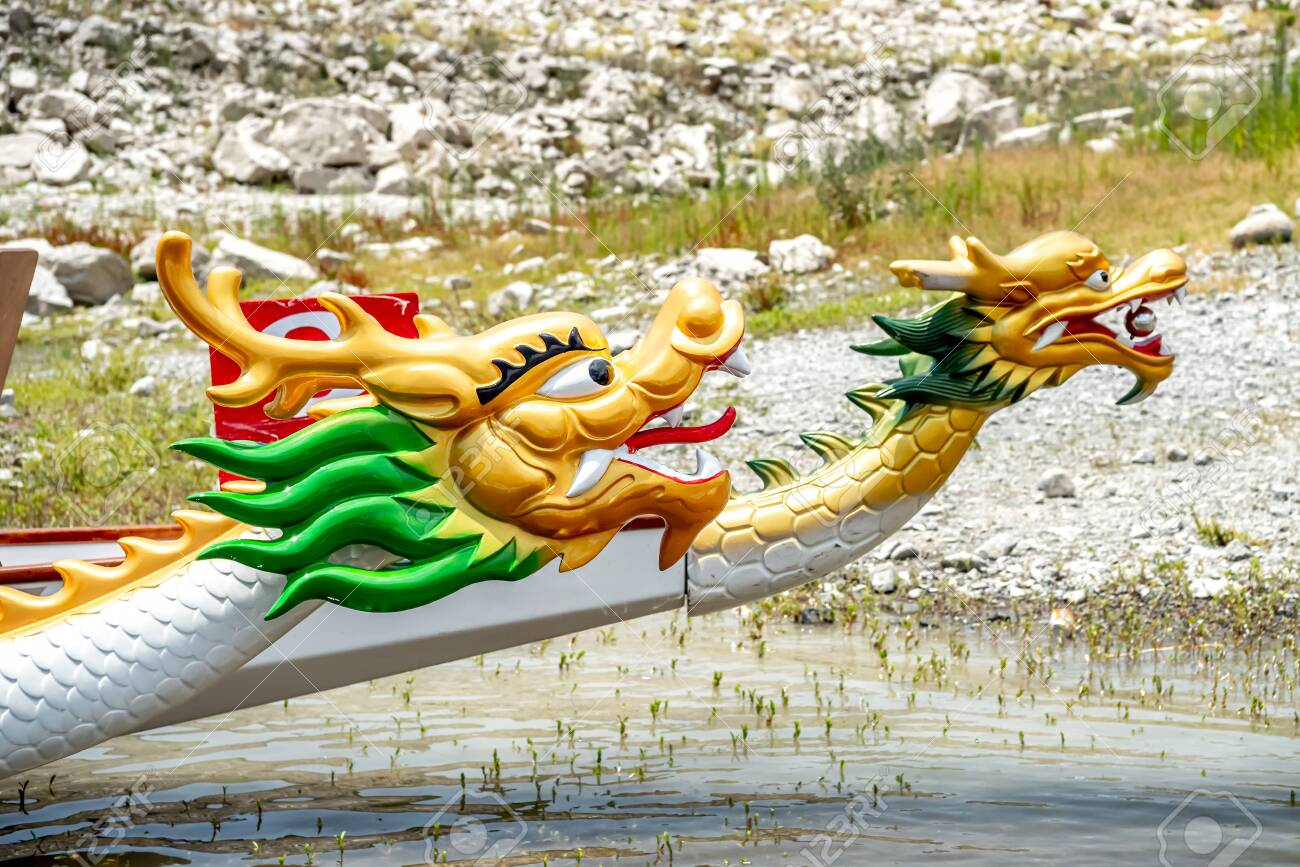 Dragon boats moored at wooden pier or jetty on the lake - 150716617