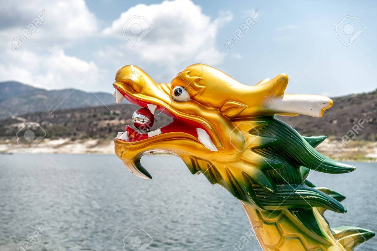 Head of a dragon on the bow of a dragon boat - 150716863