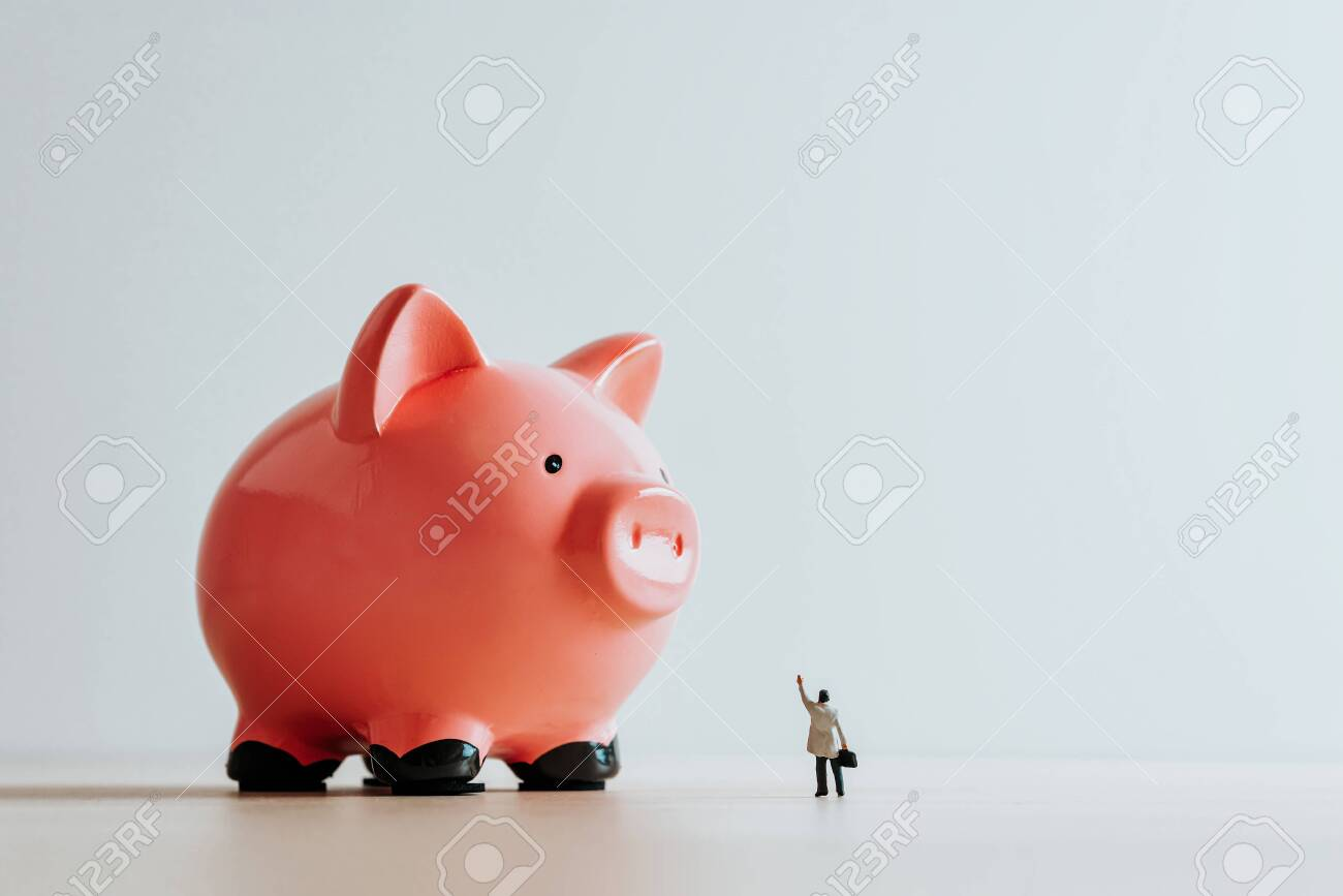 Lonely businessman and Piggy Bank. Business concept - 157377032