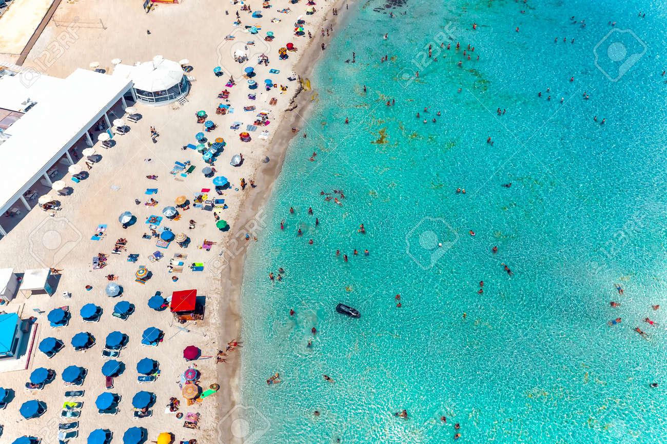 Aerial view Nissi bay beach. People, umbrellas, sand and sea wave. Famagusta District, cyprus - 157391348