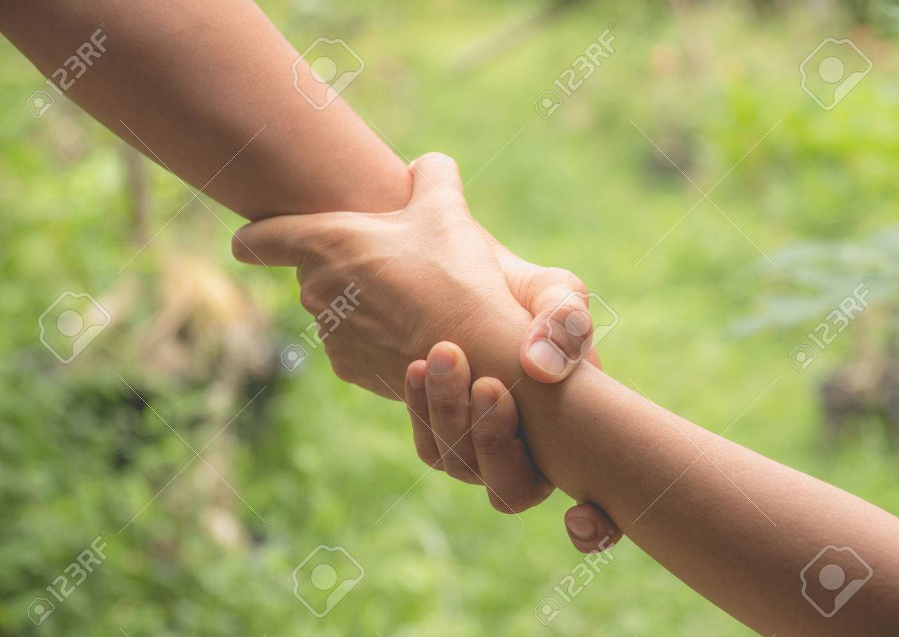 Two pairs of hand touch together, helping hands concept. Helping hand outstretched for help. - 82562227