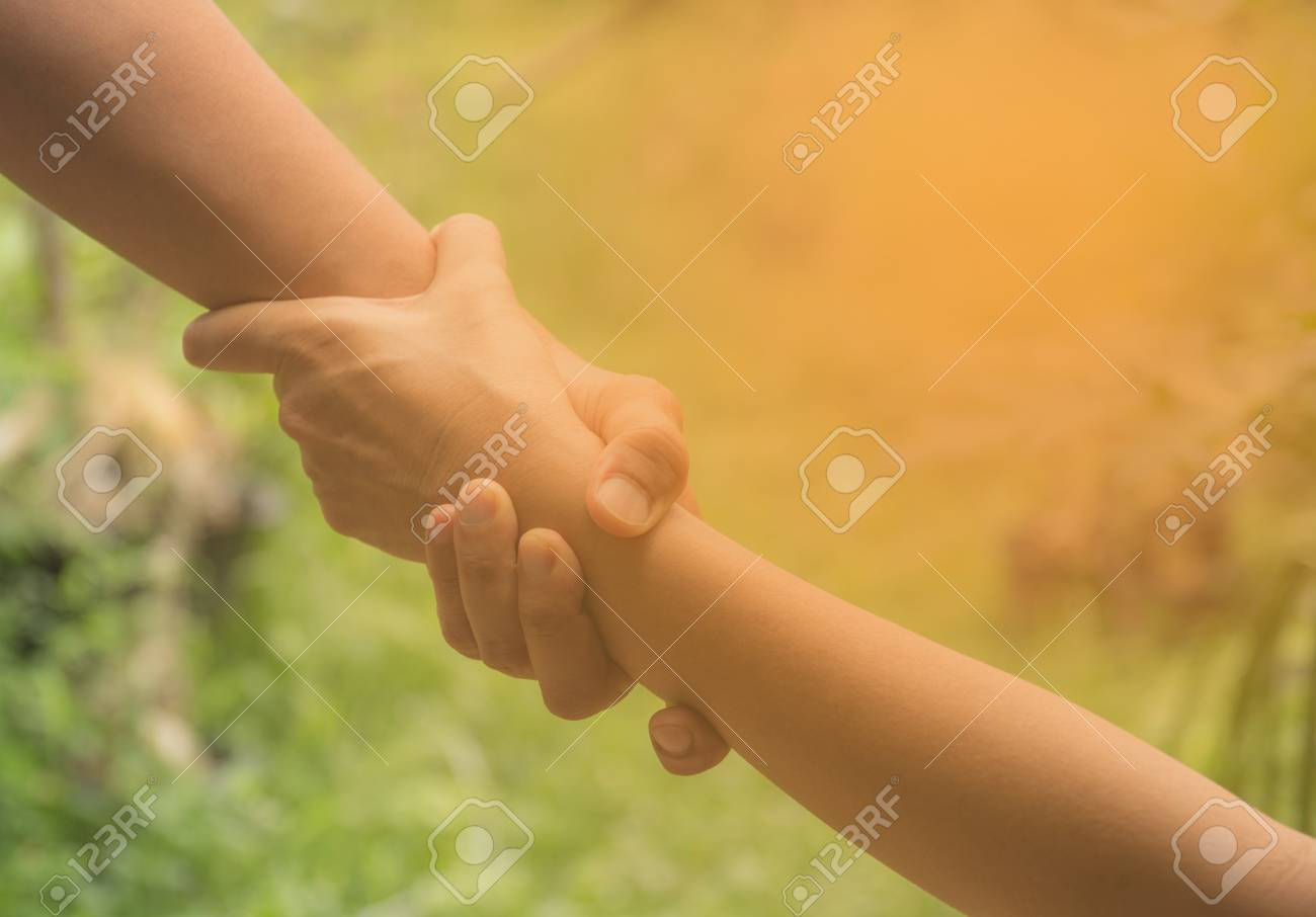 Two pairs of hand touch together, helping hands concept. Helping hand outstretched for help. - 82562222