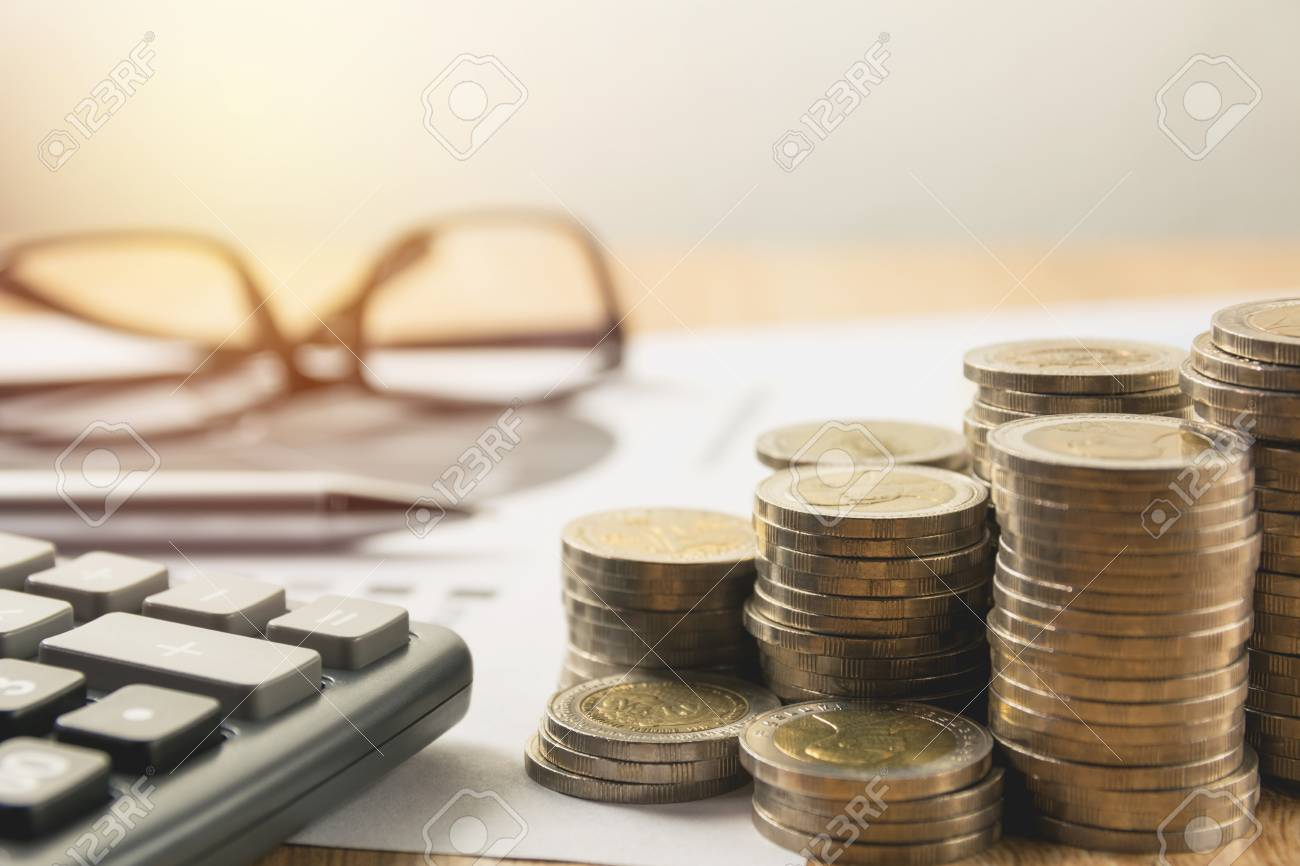 Stock financial indices with stack coin and calculator. Financial stock market in accounting market economy analysis. - 87548077