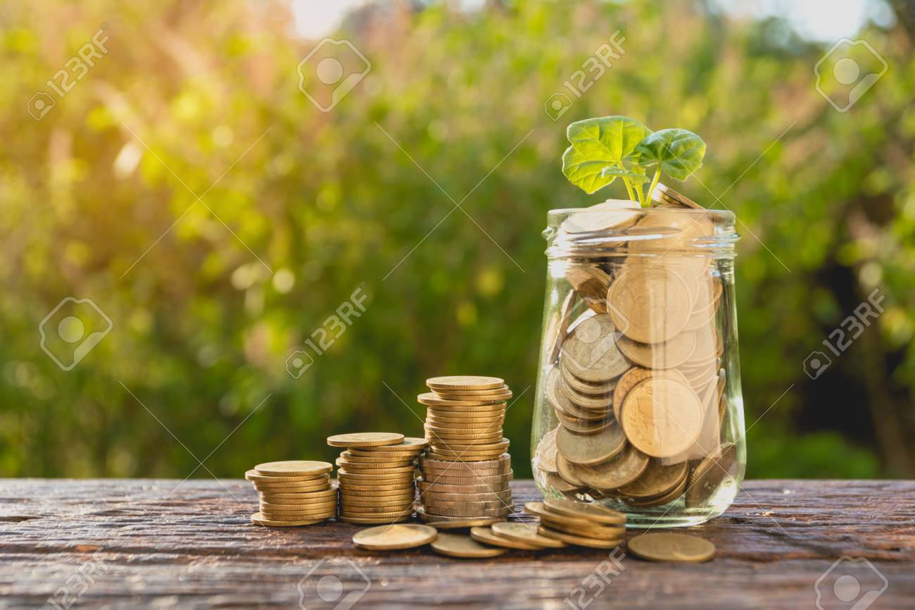 Coins in jar with money stack step growing money, Concept finance business and saving investment. - 92130576