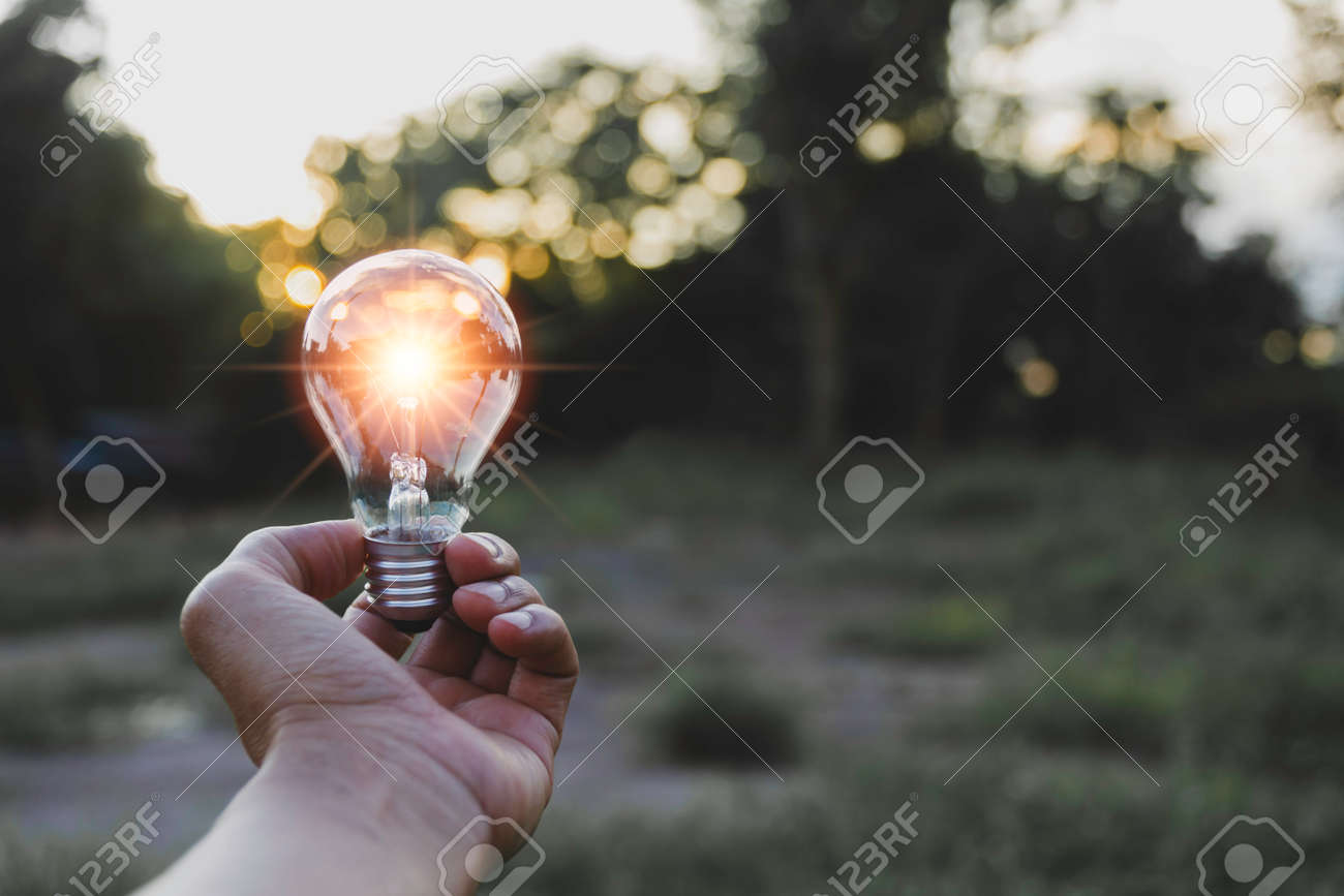 Innovation and energy concept of hand hold a light bulb and copy space for insert text. - 156925386
