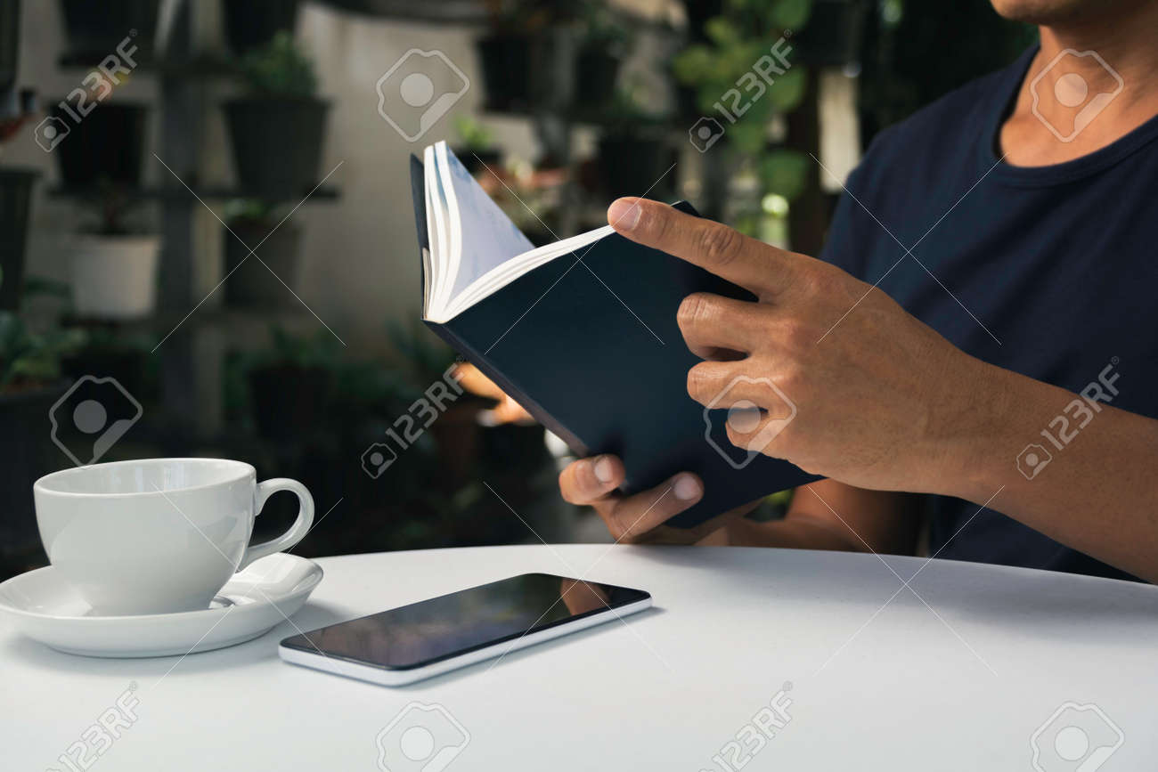 A man working at home and using laptop on the table. Technology and business concept. - 159479759