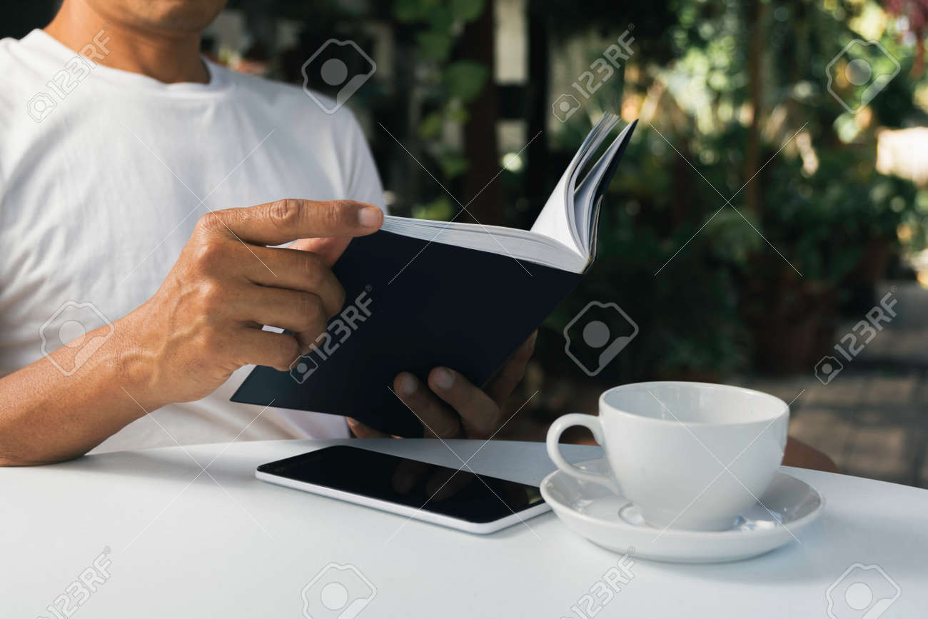 A man working at home and using laptop on the table. Technology and business concept. - 159479761