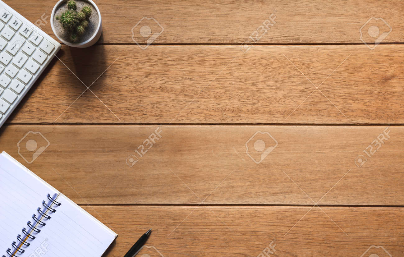 Top view of pen with other supplies, keyboard and notebook on wooden table and copy space for insert text. - 162011304