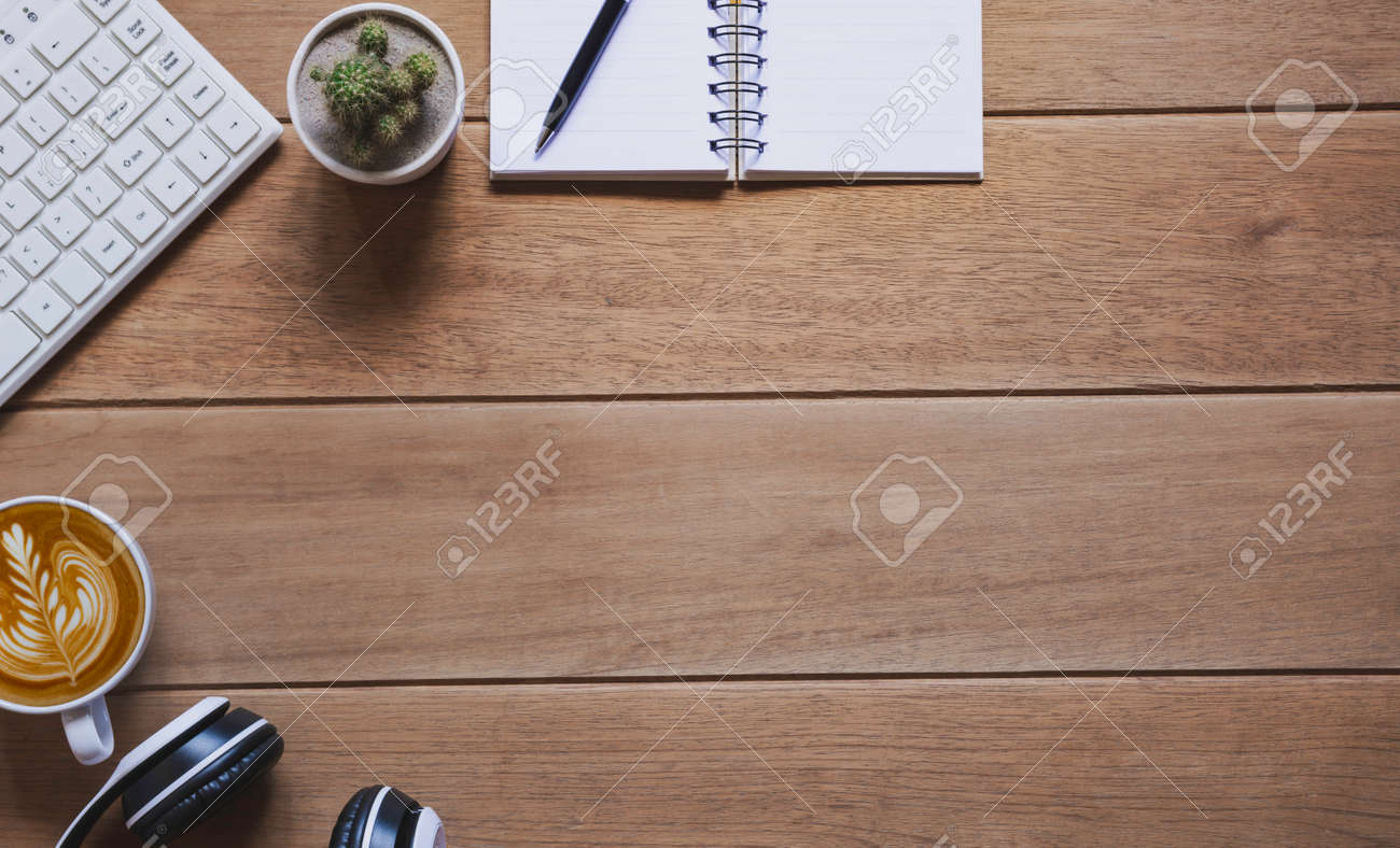 Top view of pen with other supplies, keyboard and notebook on wooden table and copy space for insert text. - 162011343