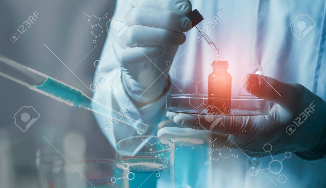Researcher with glass laboratory chemical test tubes with liquid for scientific research - 162362018