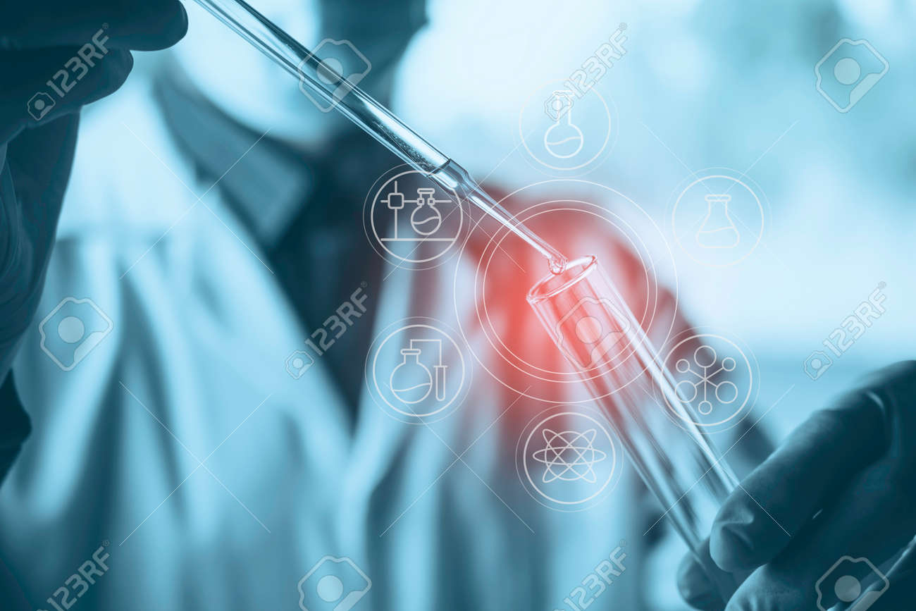 Medicine doctor with syringe in hand. Healthcare and medical concept. - 162914364