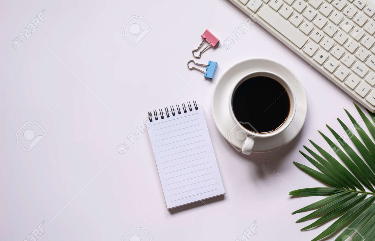 Top view of coffee with other supplies and keyboard on white background and copy space for insert text. - 163911300