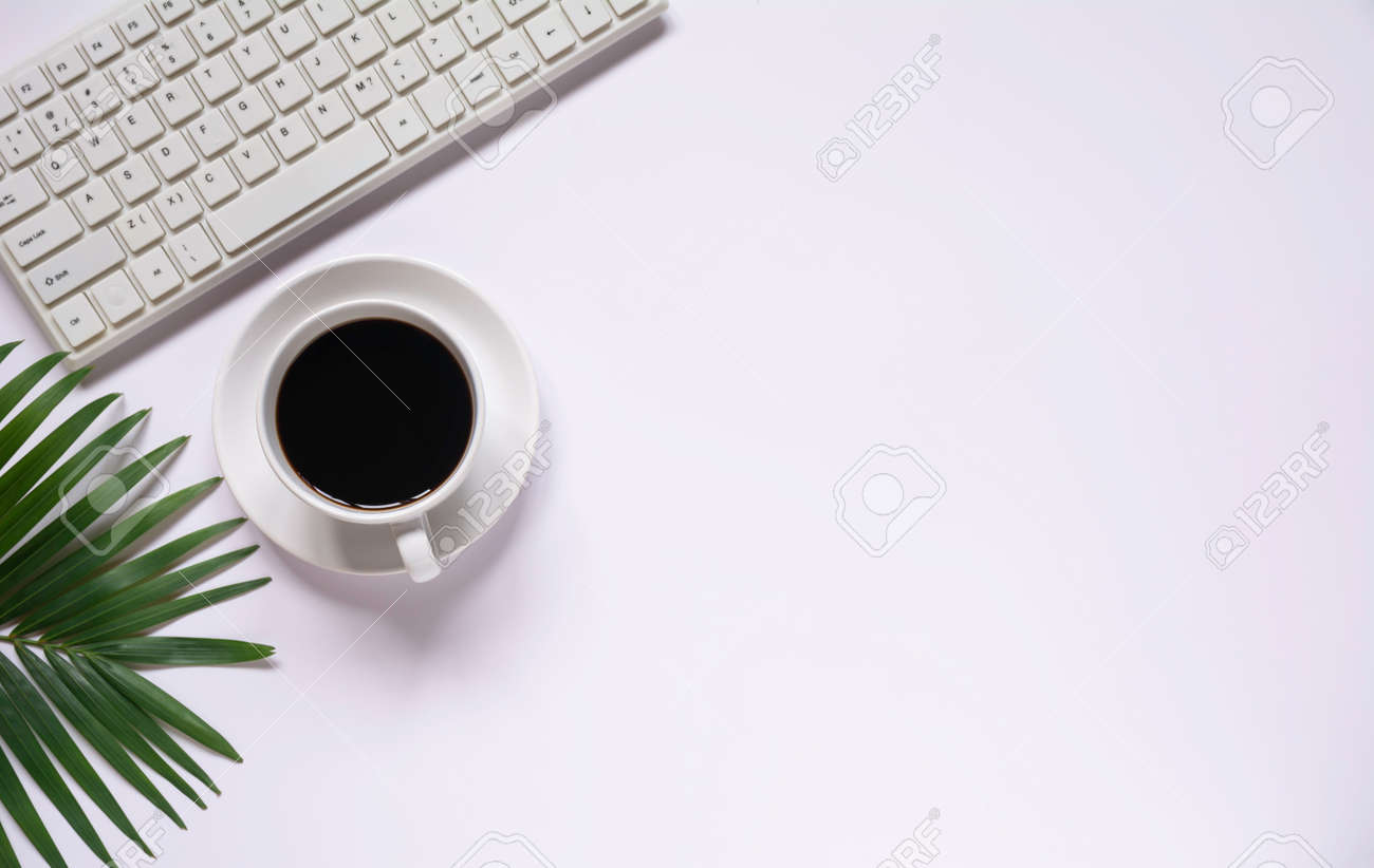 Top view of coffee with other supplies and keyboard on white background and copy space for insert text. - 163911843