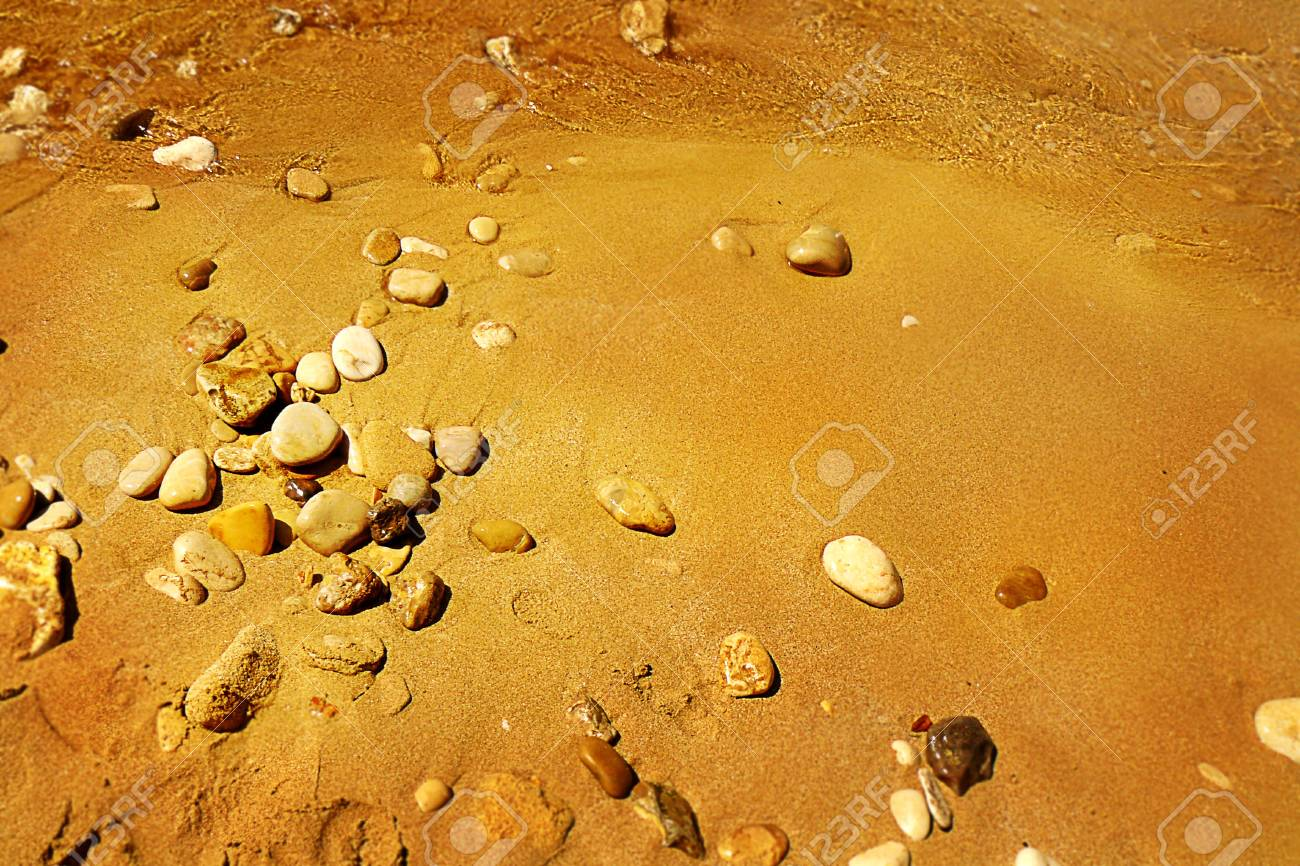 Pebbles on a sand sea shore Stock Photo - 14254657