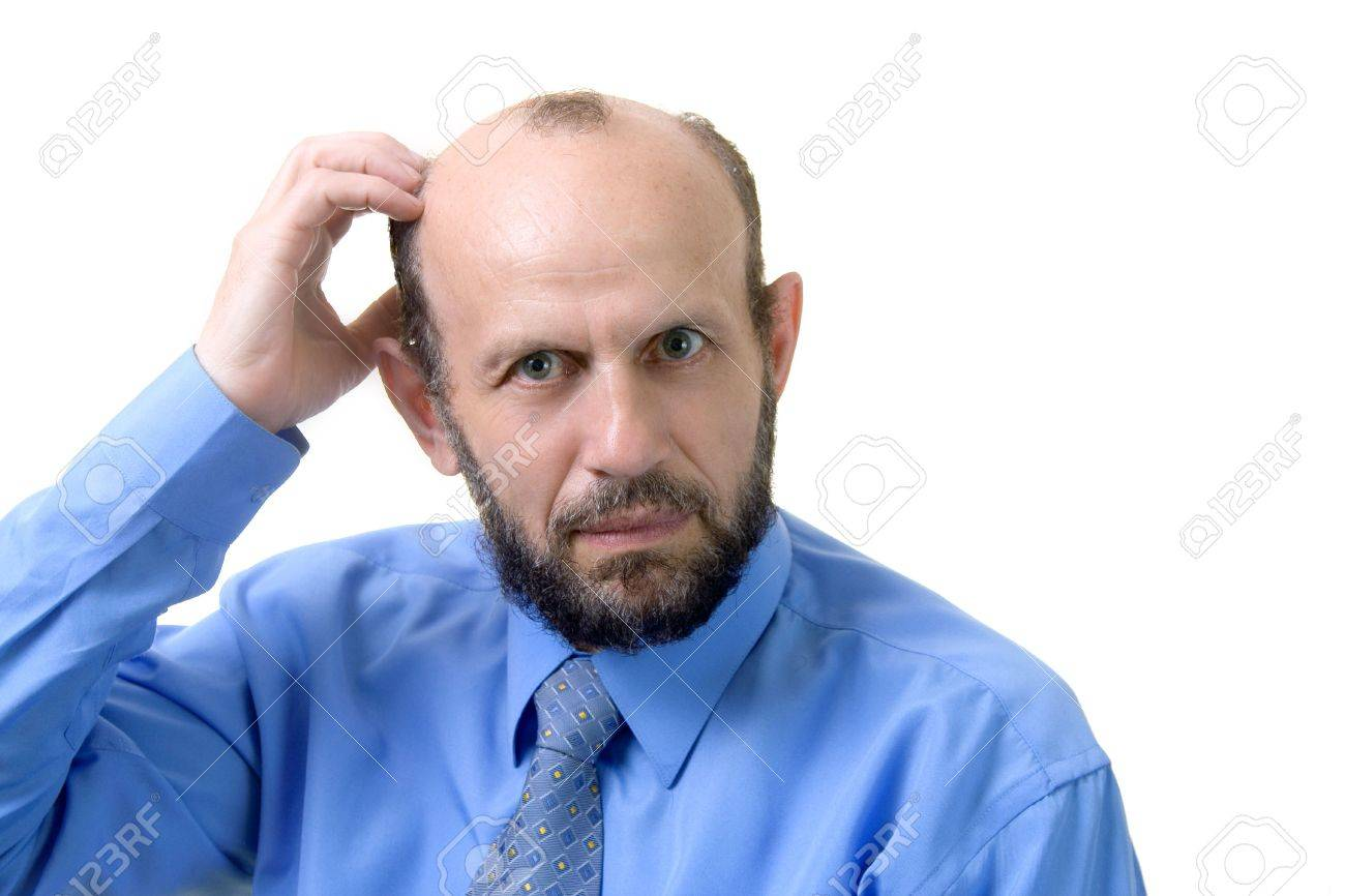 Senior man scratches his head - he is frustrated Stock Photo - 423933
