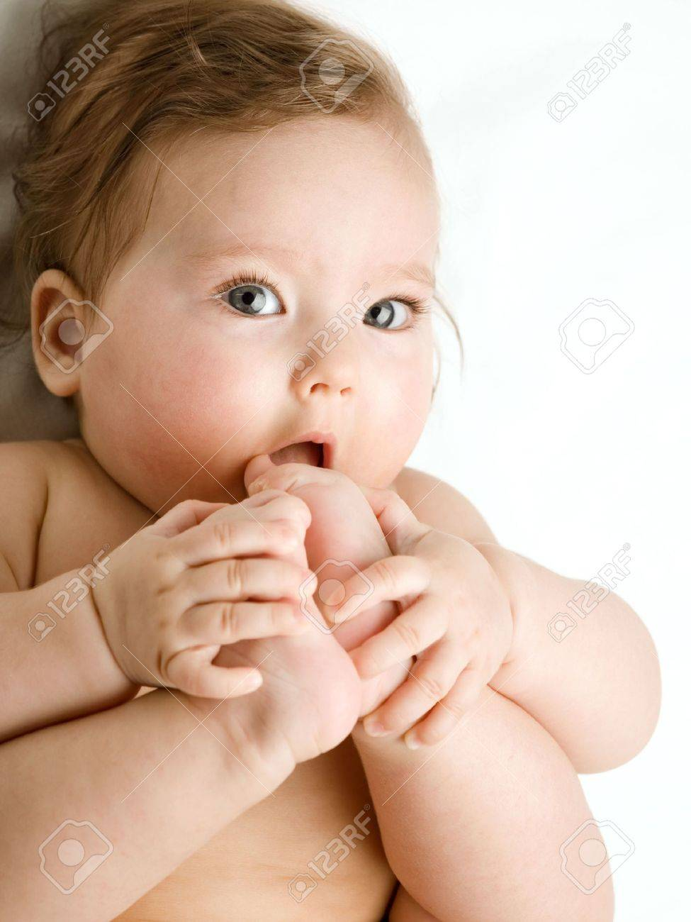A of baby, taking his feet in his mouth Stock Photo - 5226694
