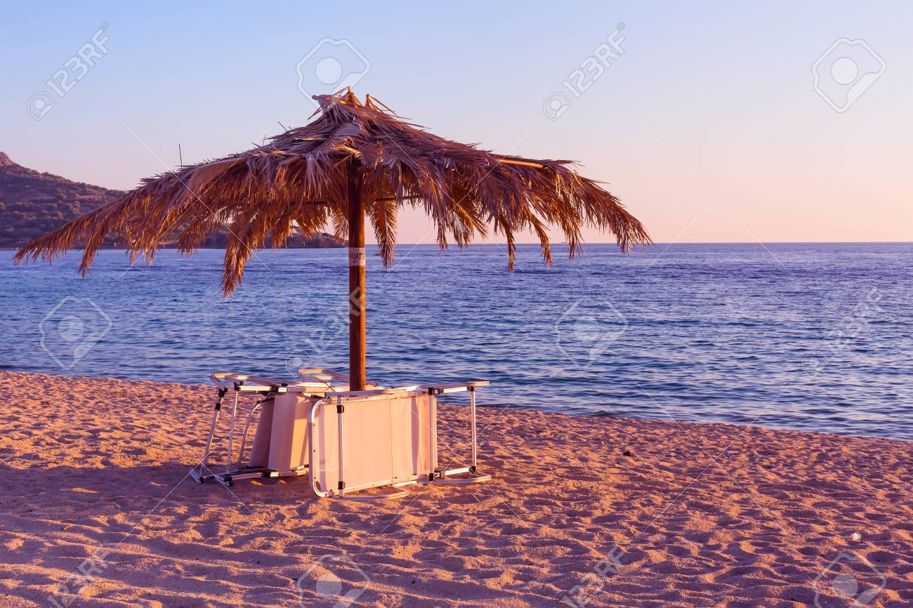 Purple Sunset Beach With Chair And Umbrella In Greece Stock Photo Picture And Royalty Free Image Image 79458277