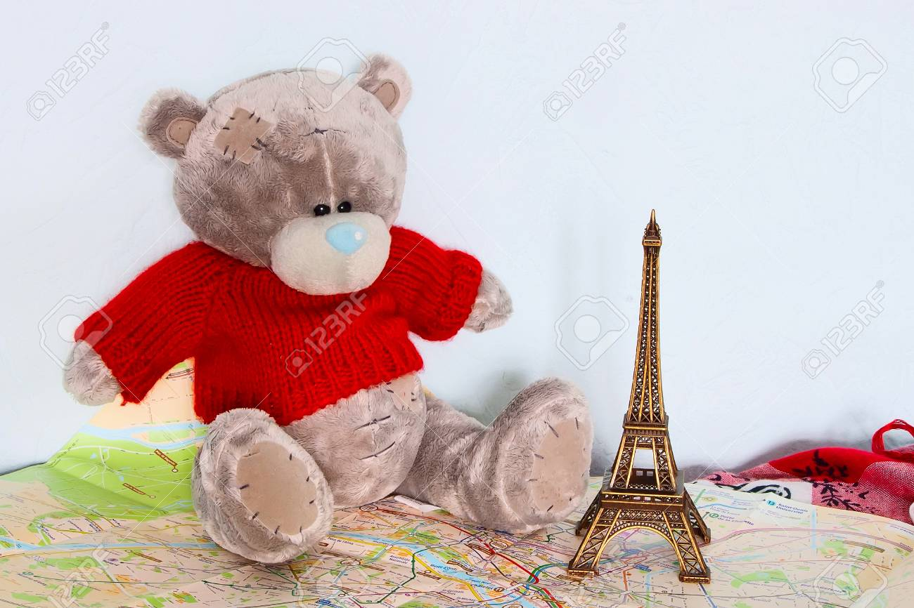 stock photo teddy bear eiffel tower on the travel map of paris travel memories background
