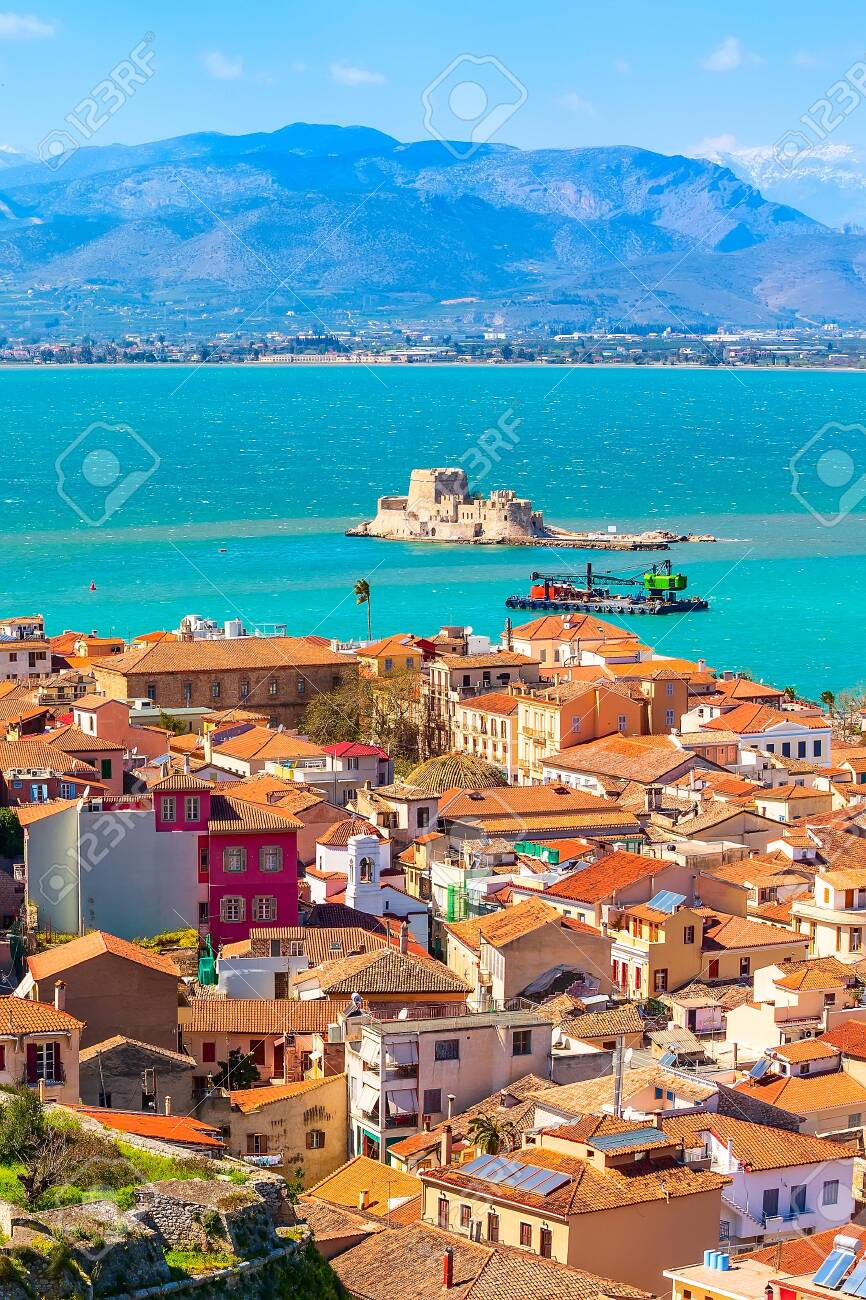 Nafplio or Nafplion, Greece, Peloponnese old town aerial panorama with sea and Bourtzi fortress - 128575691