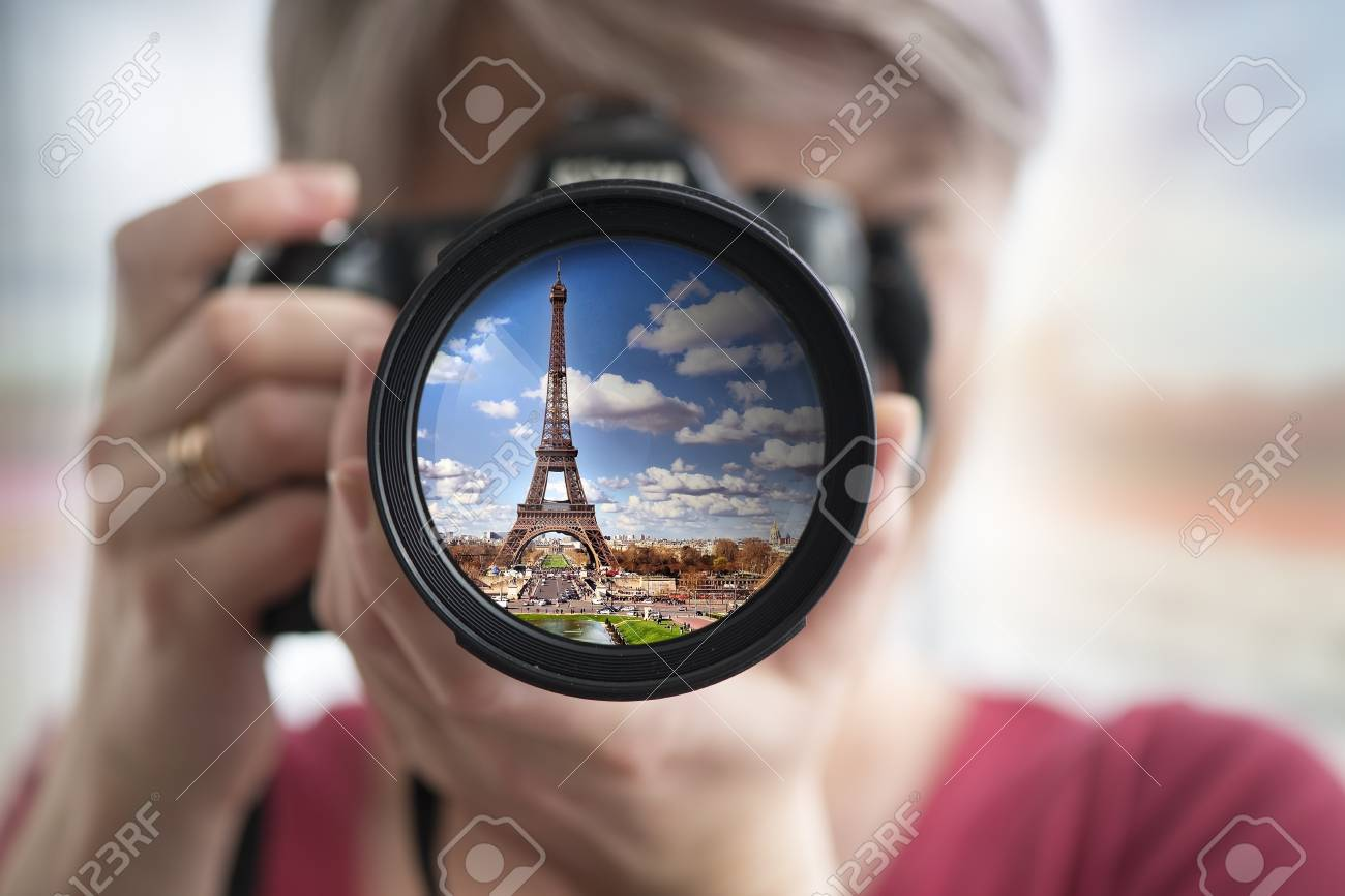 Eiffel Tower Reflection In Camera Lens With Blurred Woman Face ...