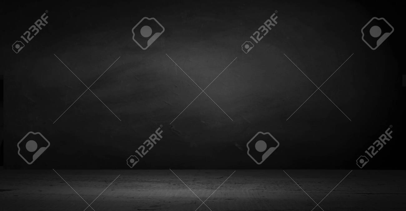 cement floor in dark room with spot light. black background. - 120730100