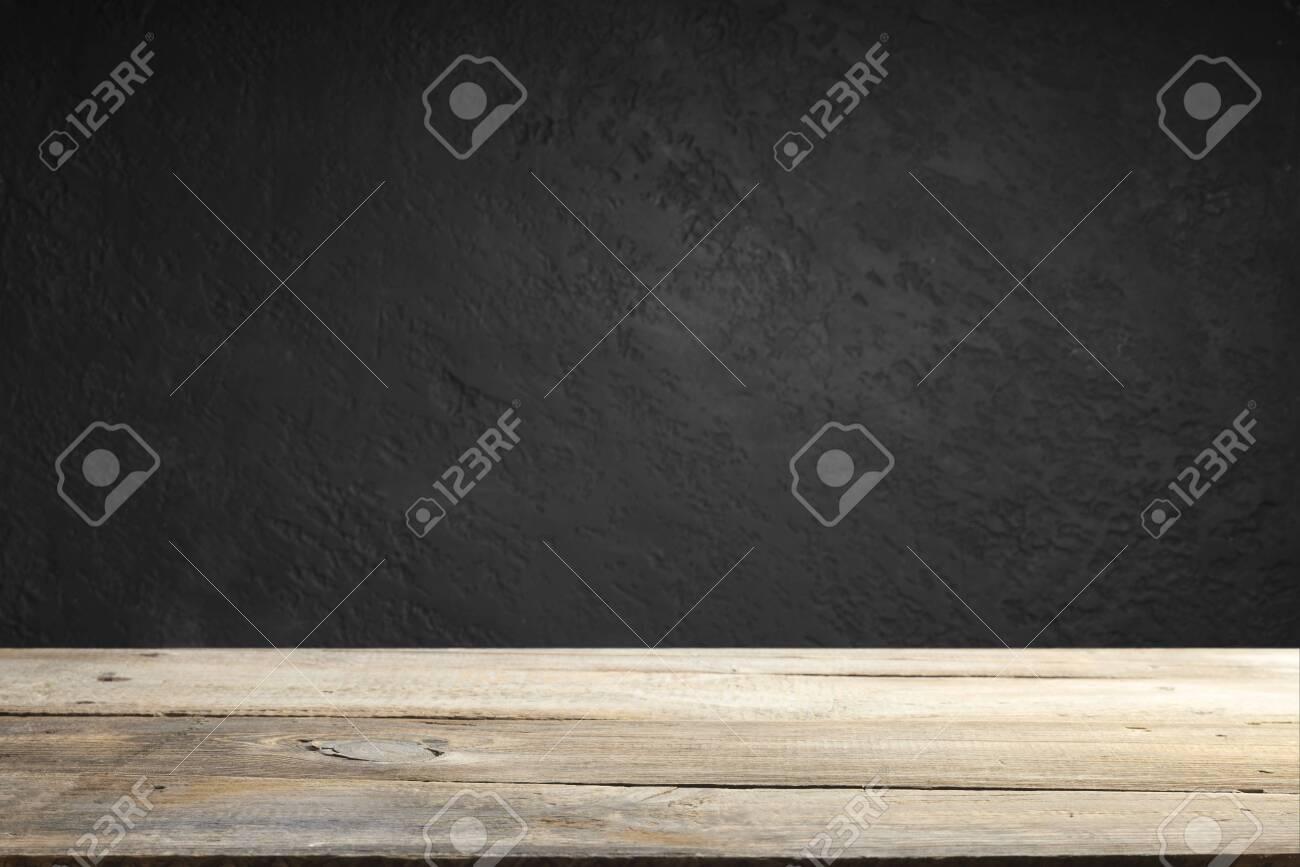 cement floor in dark room with spot light. black background. - 121774765