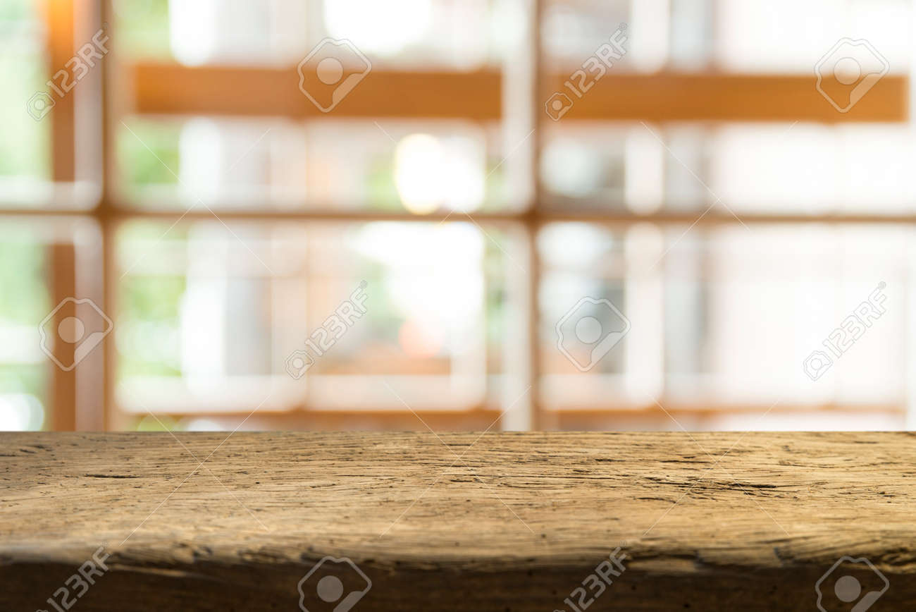 Empty of wood table top on blur of curtain with window view green from tree garden background.For montage product display or design key visual layout - 125408553