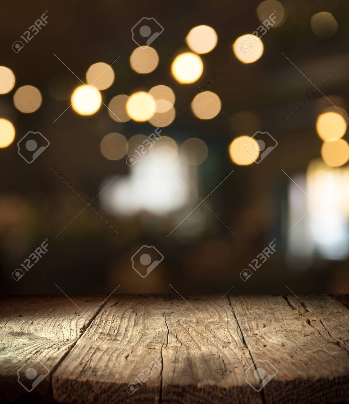 blurred background of bar and dark brown desk space of retro wood - 129231904