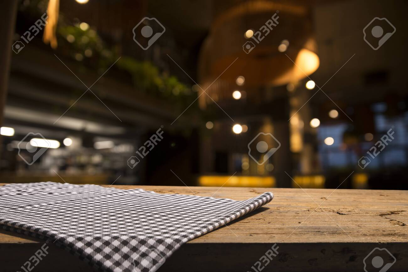 Empty Wood Table Top On Blur Light Gold Bokeh Of Cafe Restaurant Stock Photo Picture And Royalty Free Image Image 130729113