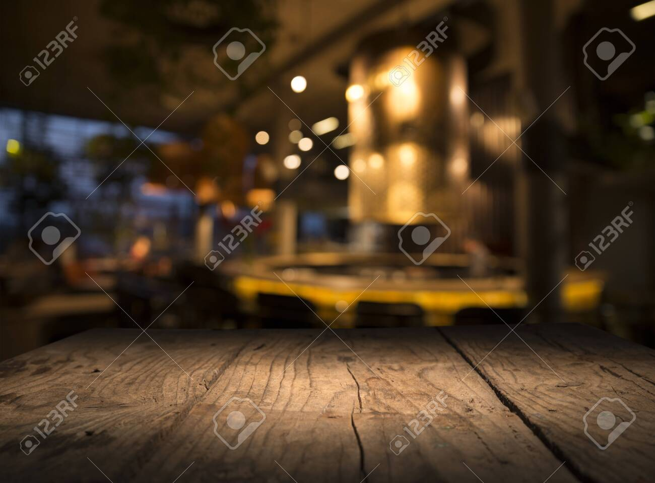 Empty Wood Table Top On Blur Light Gold Bokeh Of Cafe Restaurant Stock Photo Picture And Royalty Free Image Image 130729225