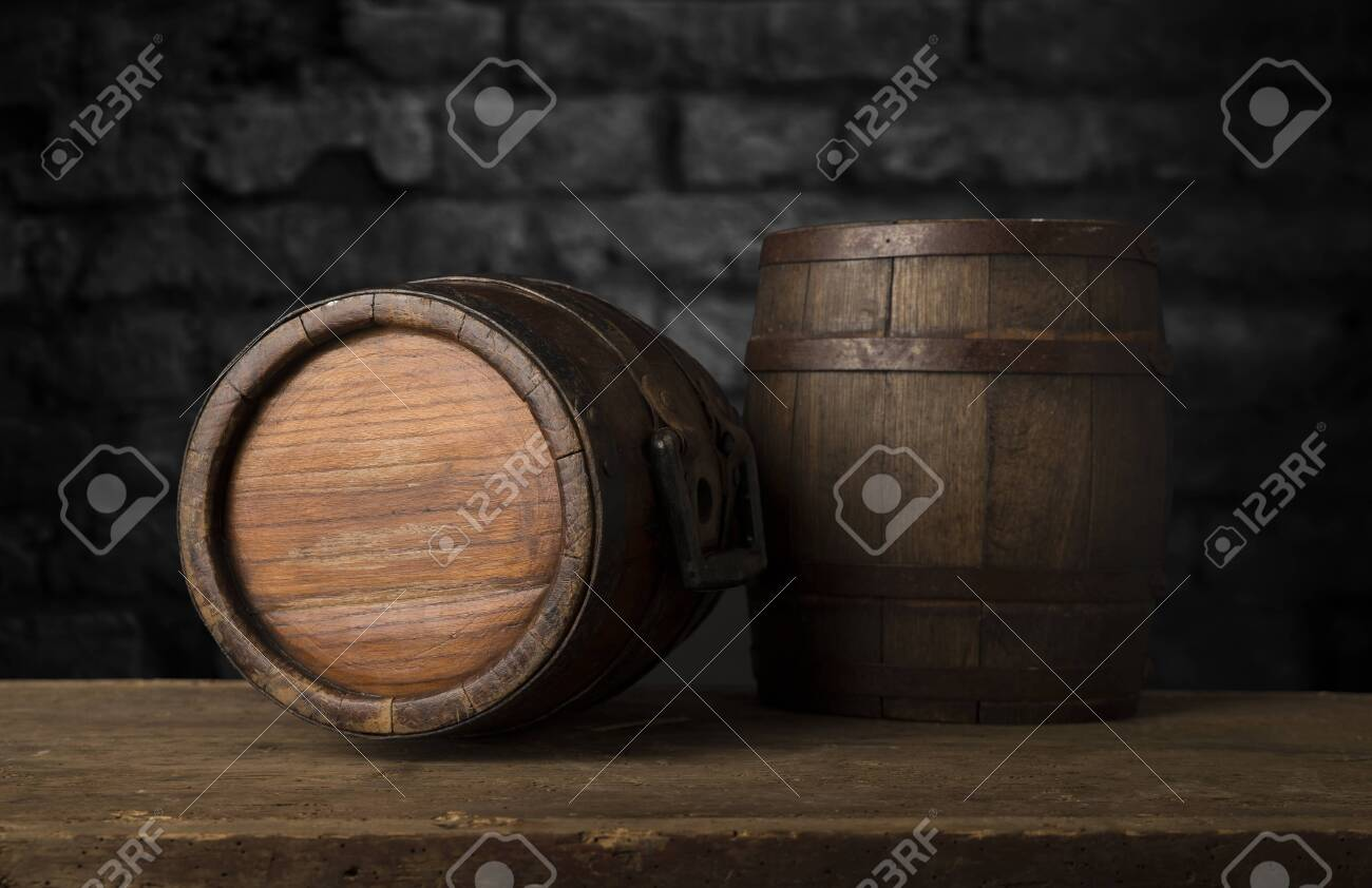 background of barrel and worn old table of wood - 135703981