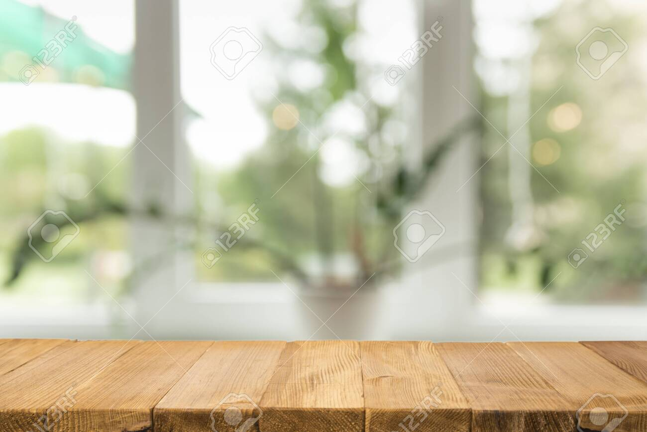 Empty brown wooden table and blur background of abstract of resturant lights people enjoy eating ,can be used for montage or display your products - 138468440