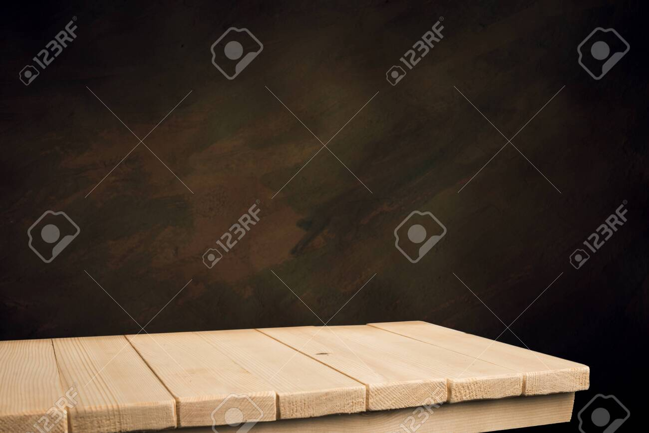 Selected focus empty brown wooden table and wall texture or old black brick wall blur background image. for your photomontage or product display - 144239798