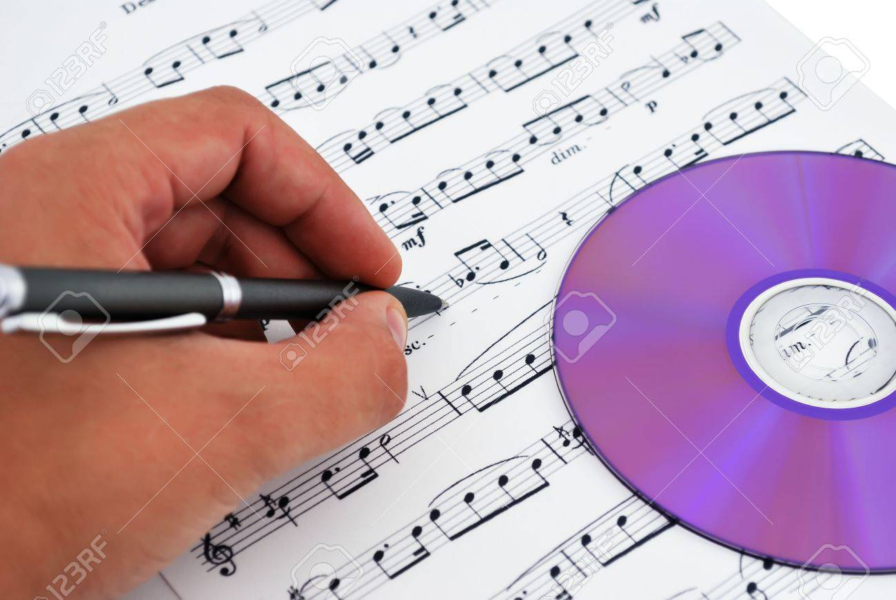 cd or dvd drive, musical notes and hand make notes Stock Photo - 7905945