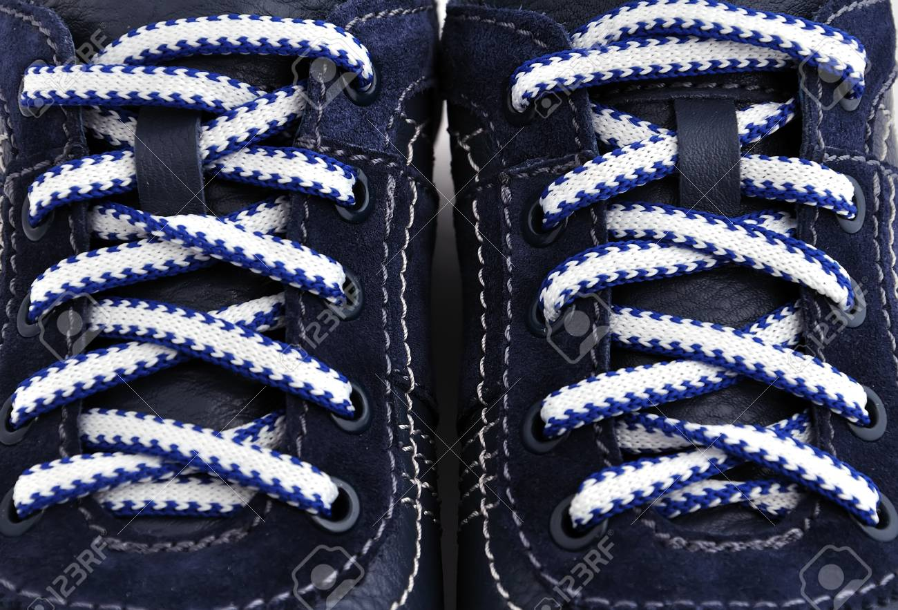 strung blue sneakers. close up Stock Photo - 12756732