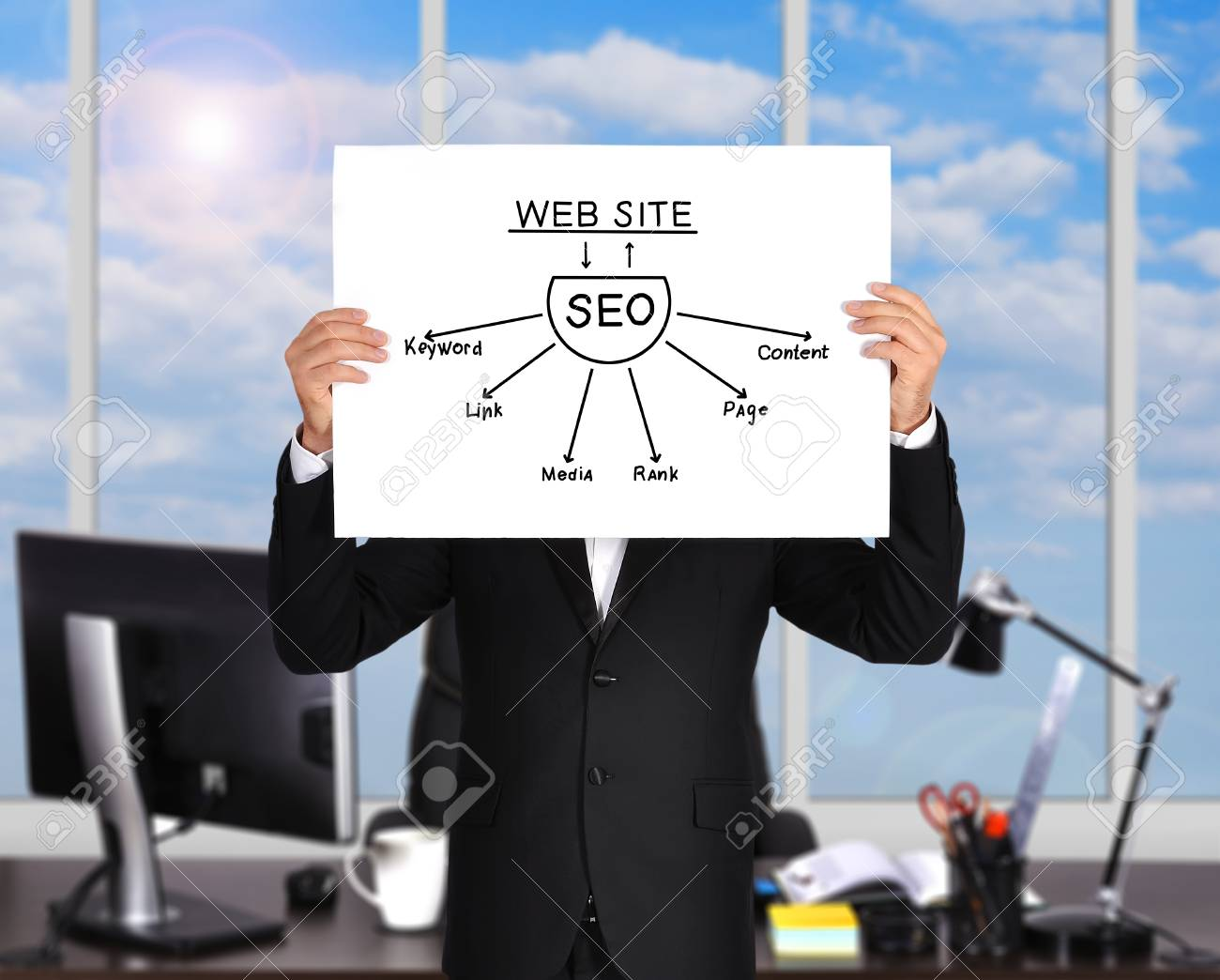 businessman standing in office and holding  poster with seo scheme Stock Photo - 28235608