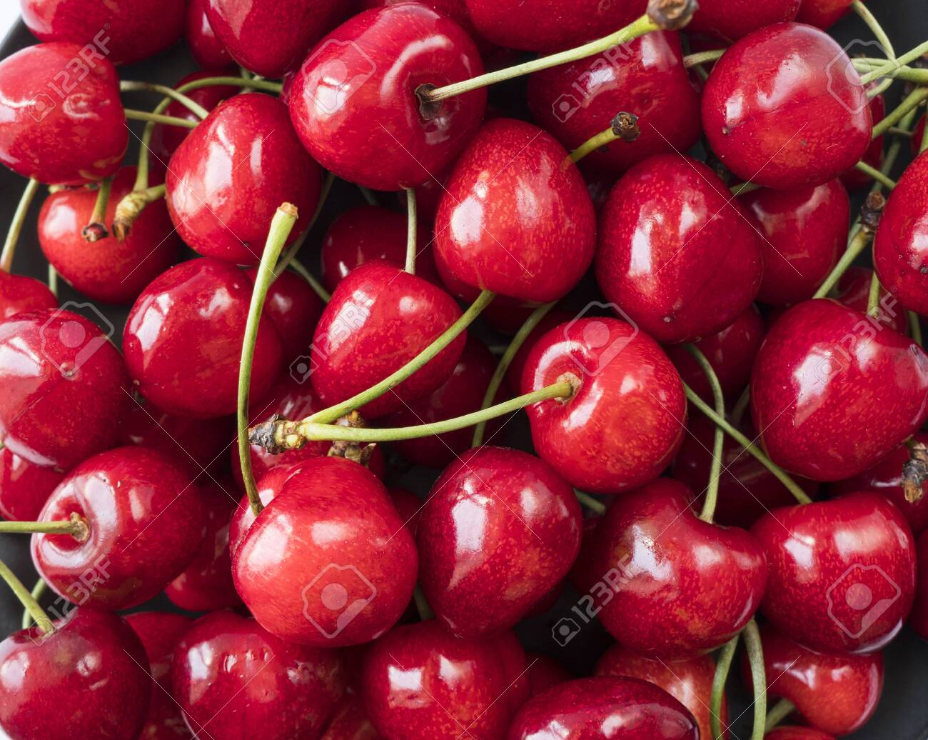 Fresh red cherries. Texture cherries fruits close up. Cherry fruit. Cherries with copy space for text. Top view. Background of cherries. - 125787631