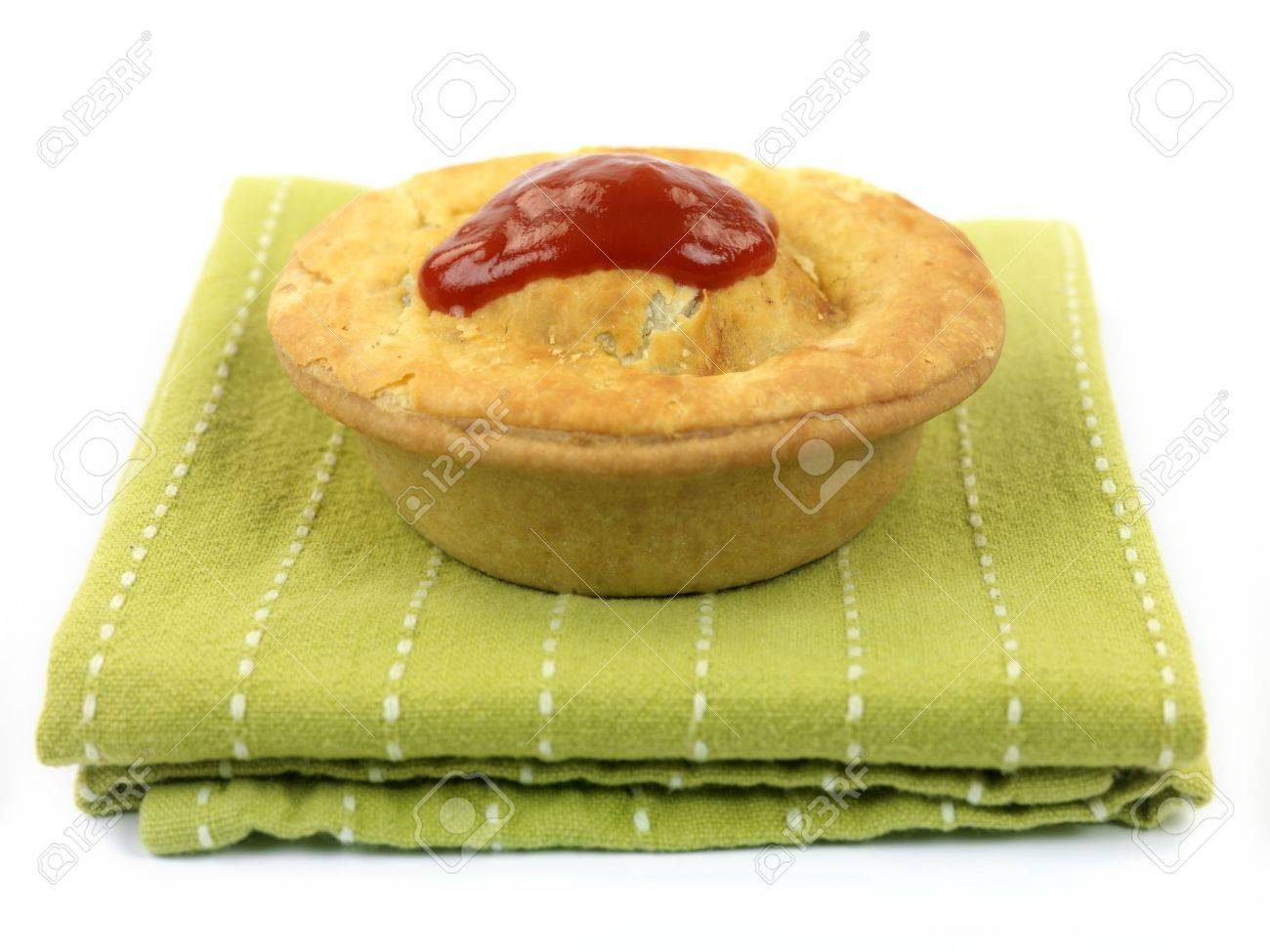 An Australian meat pie served on a napkin isolated against a white background Stock Photo - 6437337