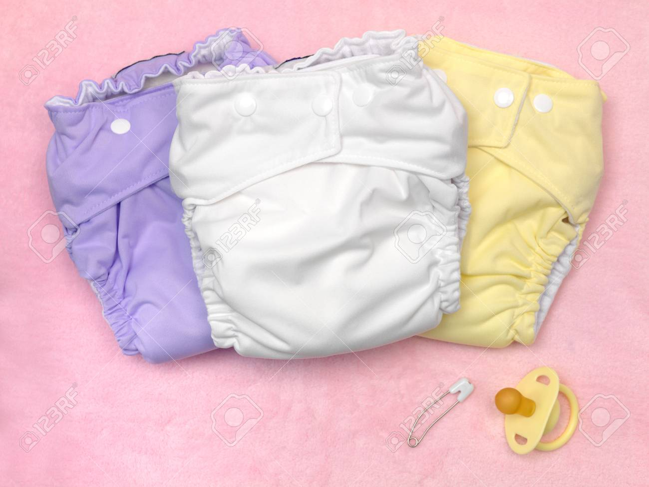 A modern cloth nappy isolated against a pink background Stock Photo - 7513709