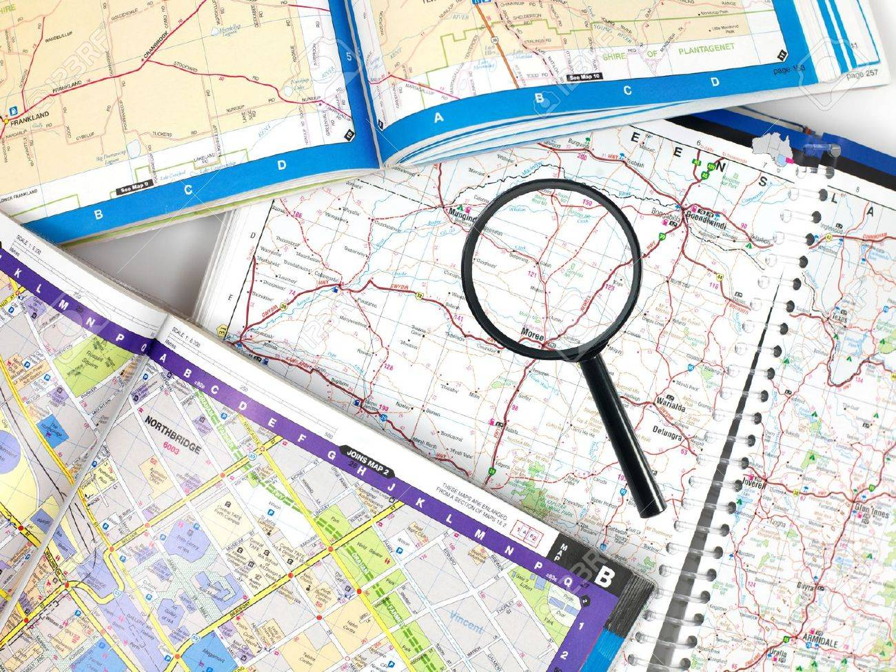 A road map with a magnifying glass Stock Photo - 10427630