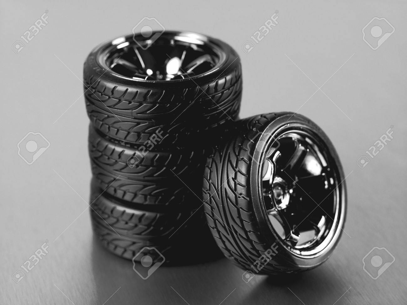 Rubber tyres with sports rims on a silver background Stock Photo - 10485962