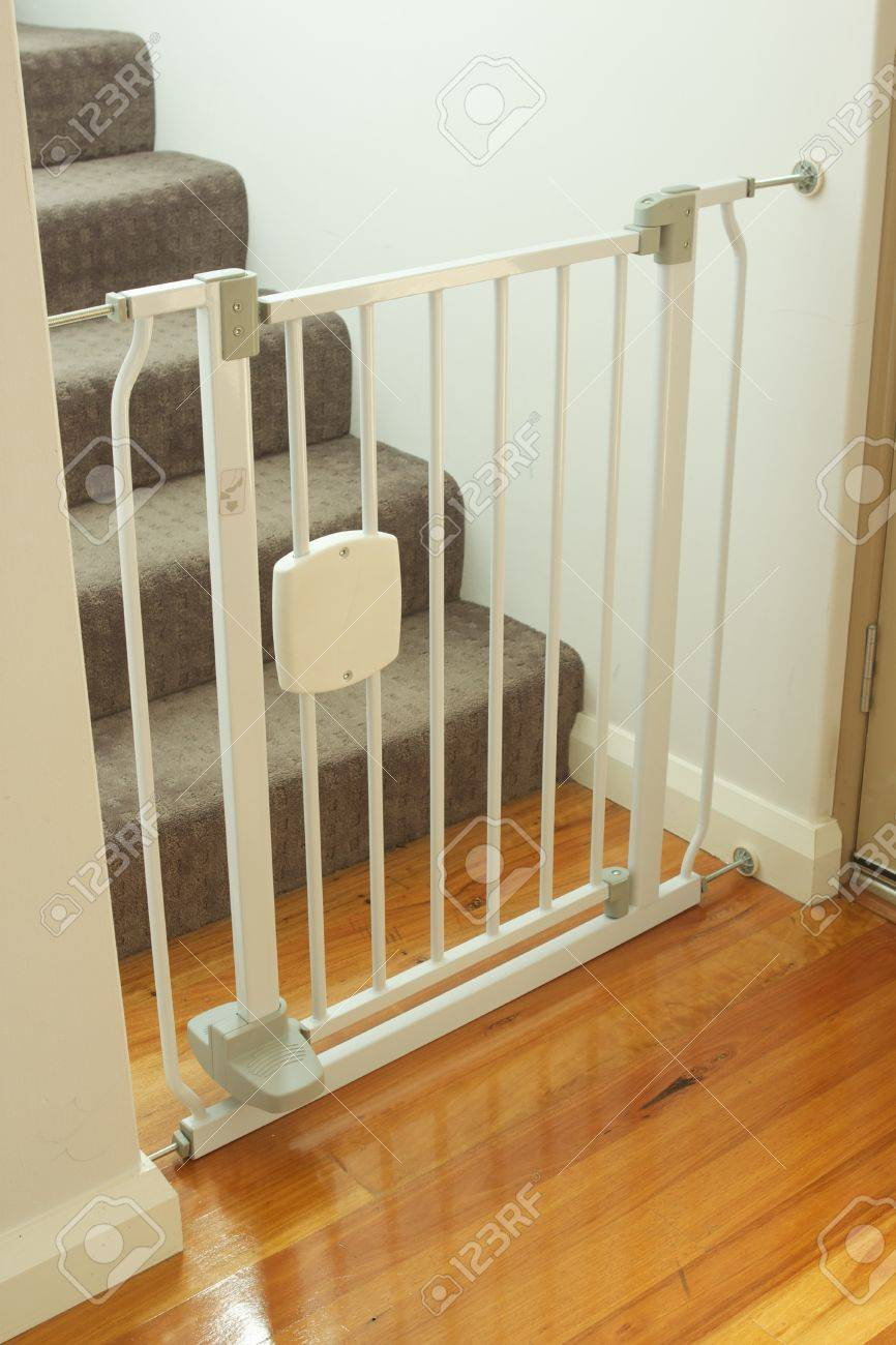 A Shot Of A Child Safety Gate And Stairs Stock Photo Picture And