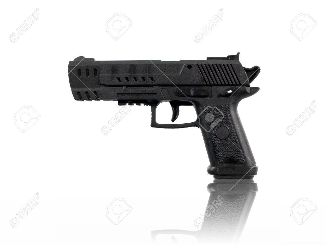 A toy hand gun isolated against a white background Stock Photo - 12388900