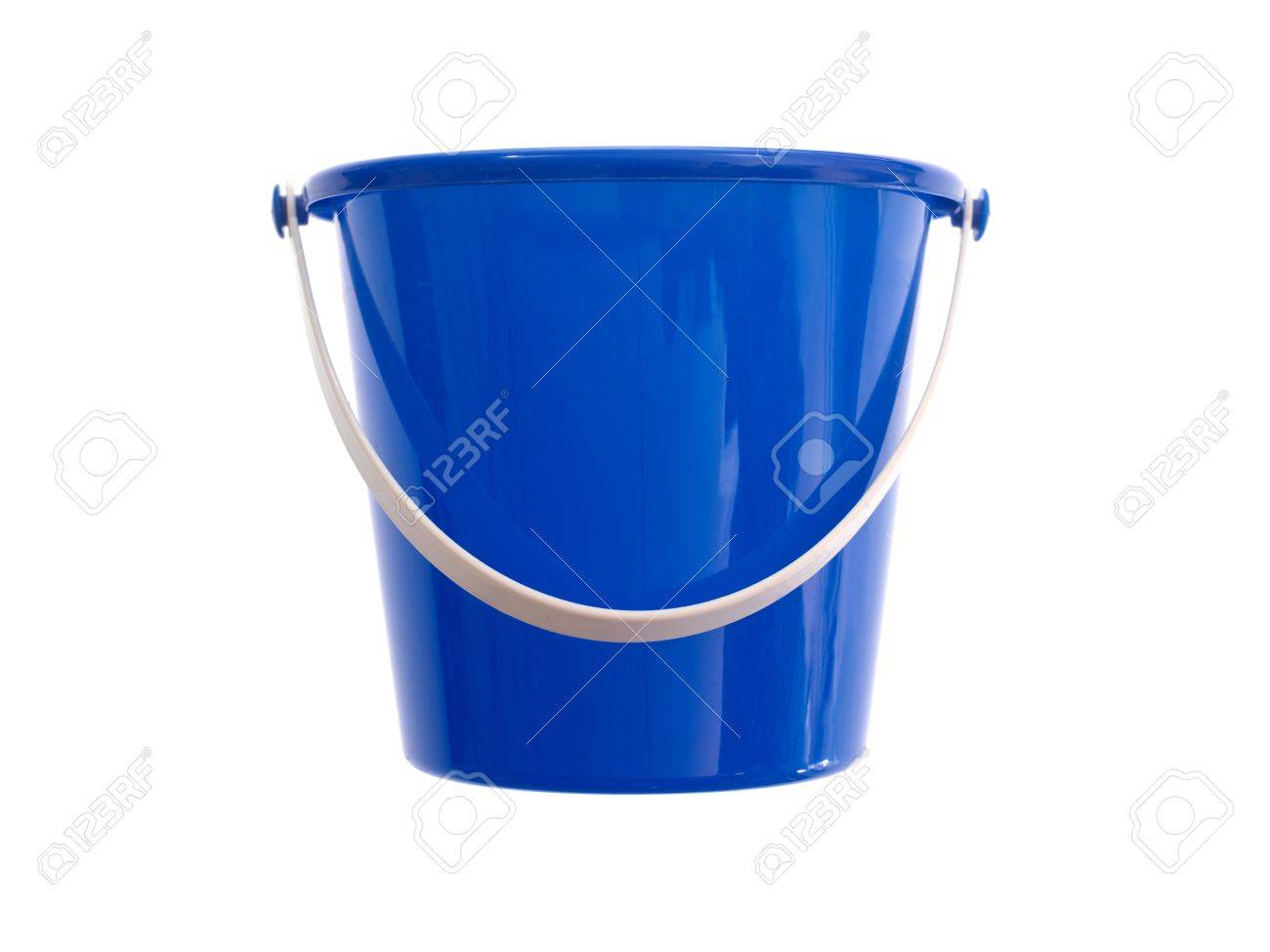 A toy bucket and spade set  isolated against a white background Stock Photo - 13545583