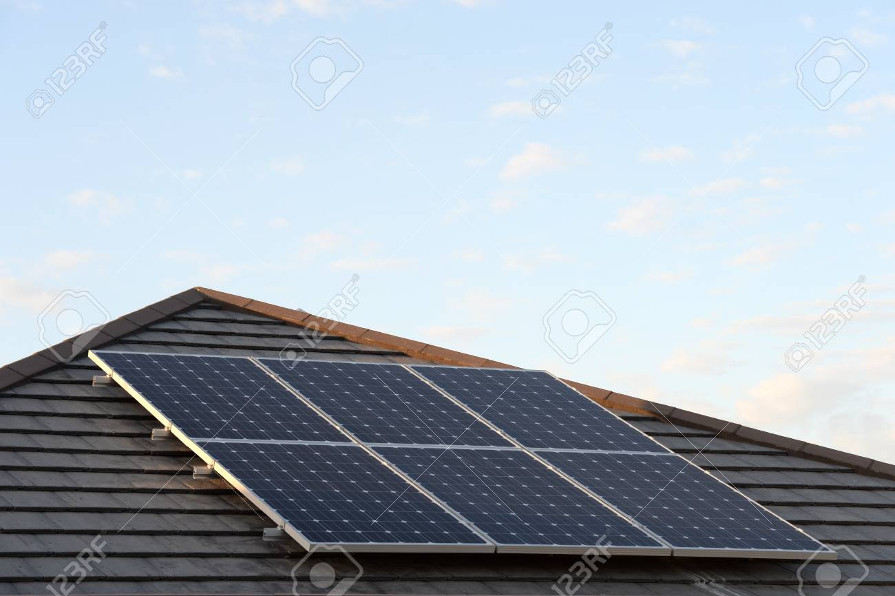 A Shot Of Solar Panels Of A Tiled Roof Stock Photo, Picture And ...