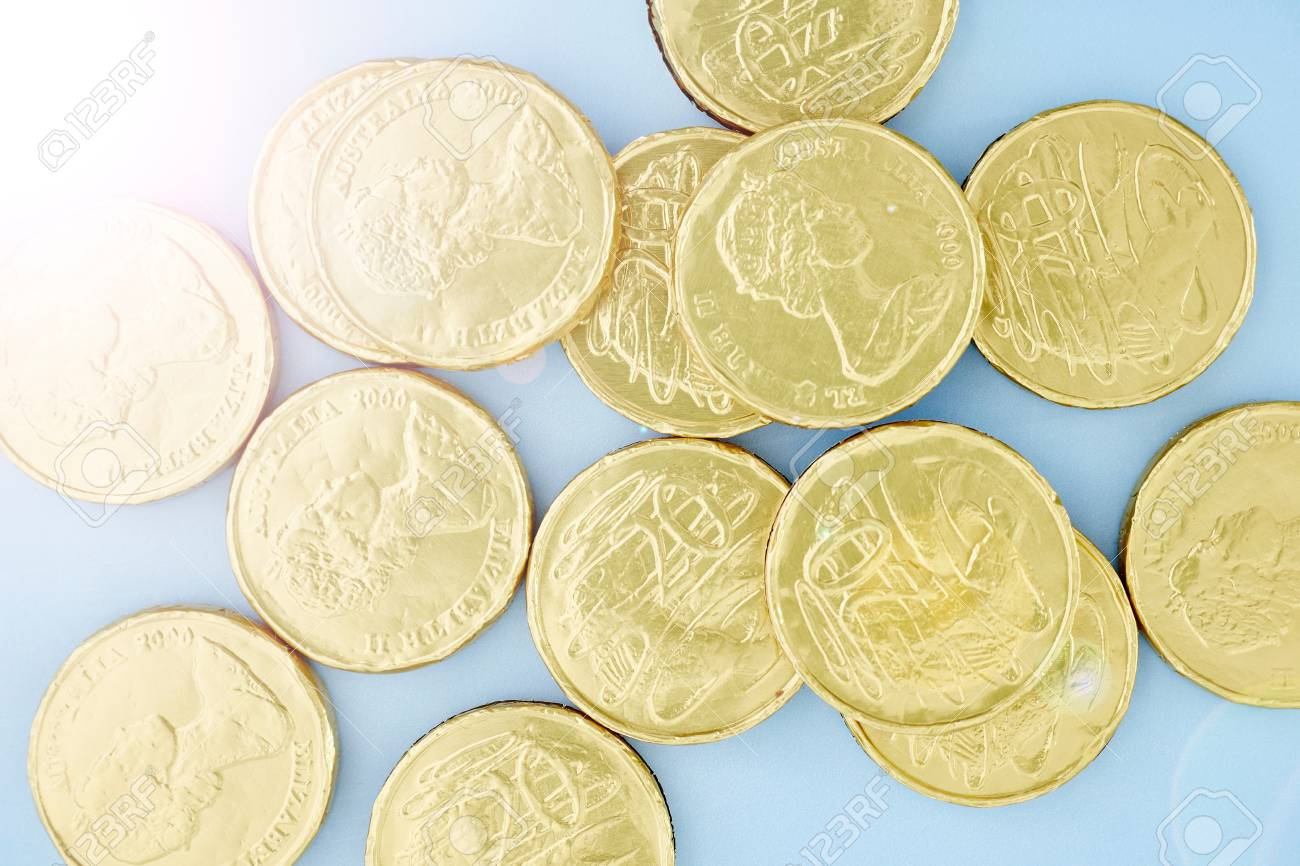 A studio photo of chocolate gold coins
