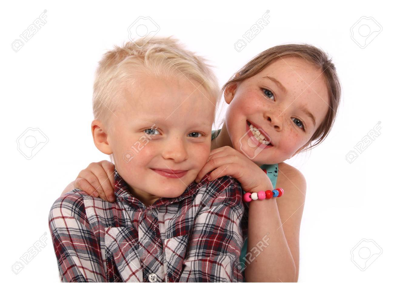 brother and sister pose for a photo together on a white background Stock Photo - 15644085