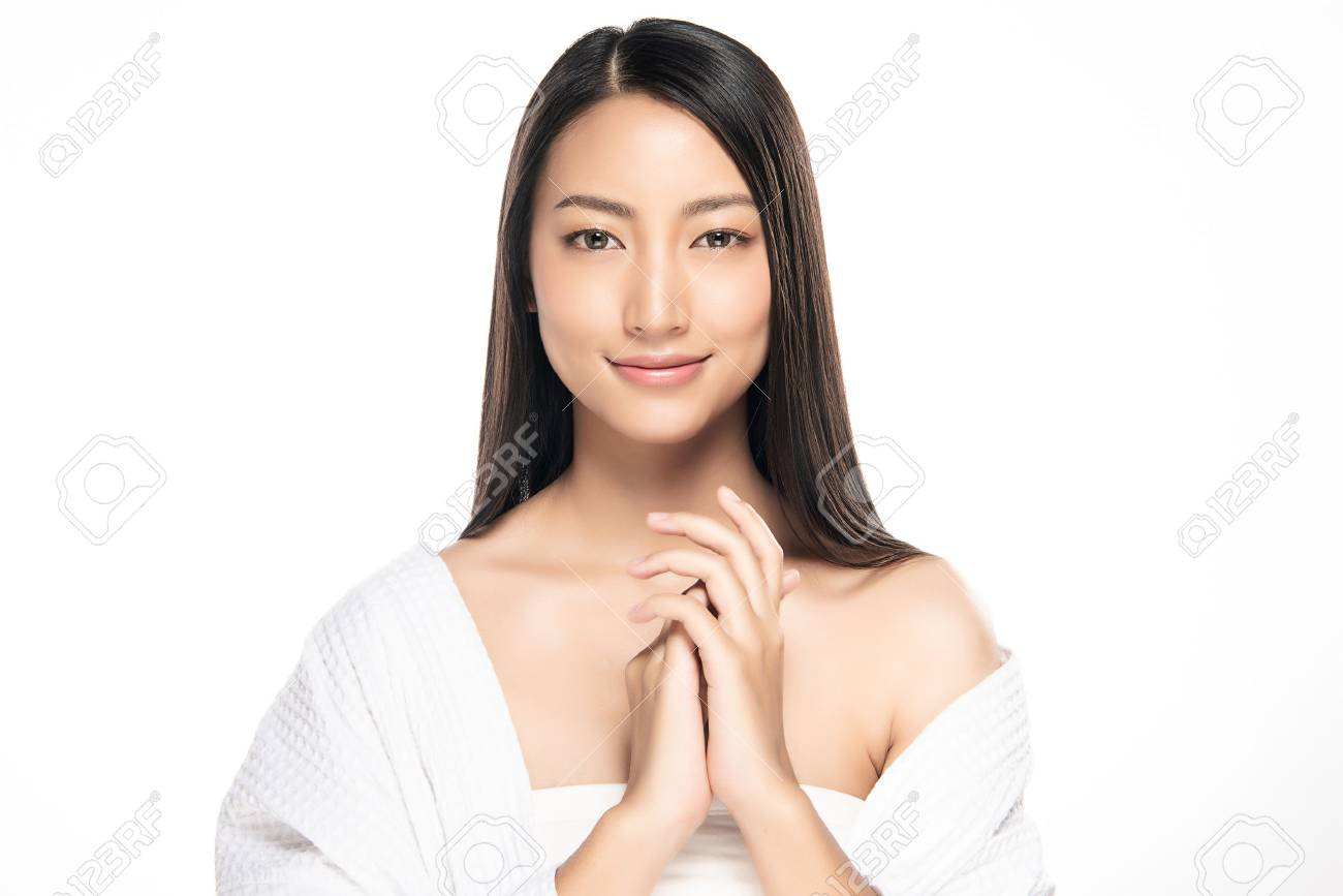 Beautiful Young Woman with Clean Fresh Skin. Face care . Facial treatment . Cosmetology , beauty and spa. Asian women portrait - 119507240
