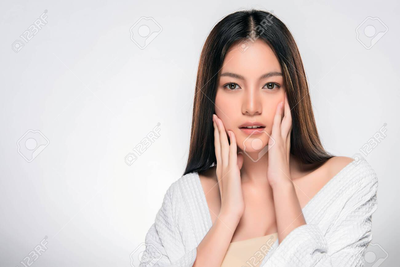 Beautiful Young Woman With Clean Fresh Skin Face Care Facial